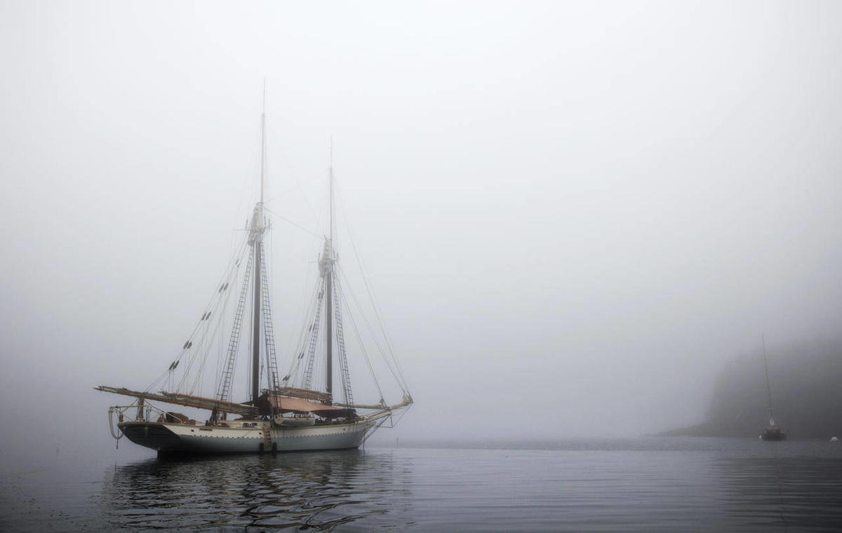 In this photo made Friday, Aug. 3, 2012, the schooner Mary Day sits at anchor in the morning fog off South Brooksville, Maine. The 90-foot Mary Day, which is celebrating its 50th season, is the first schooner in the Maine windjammer fleet to be built spec