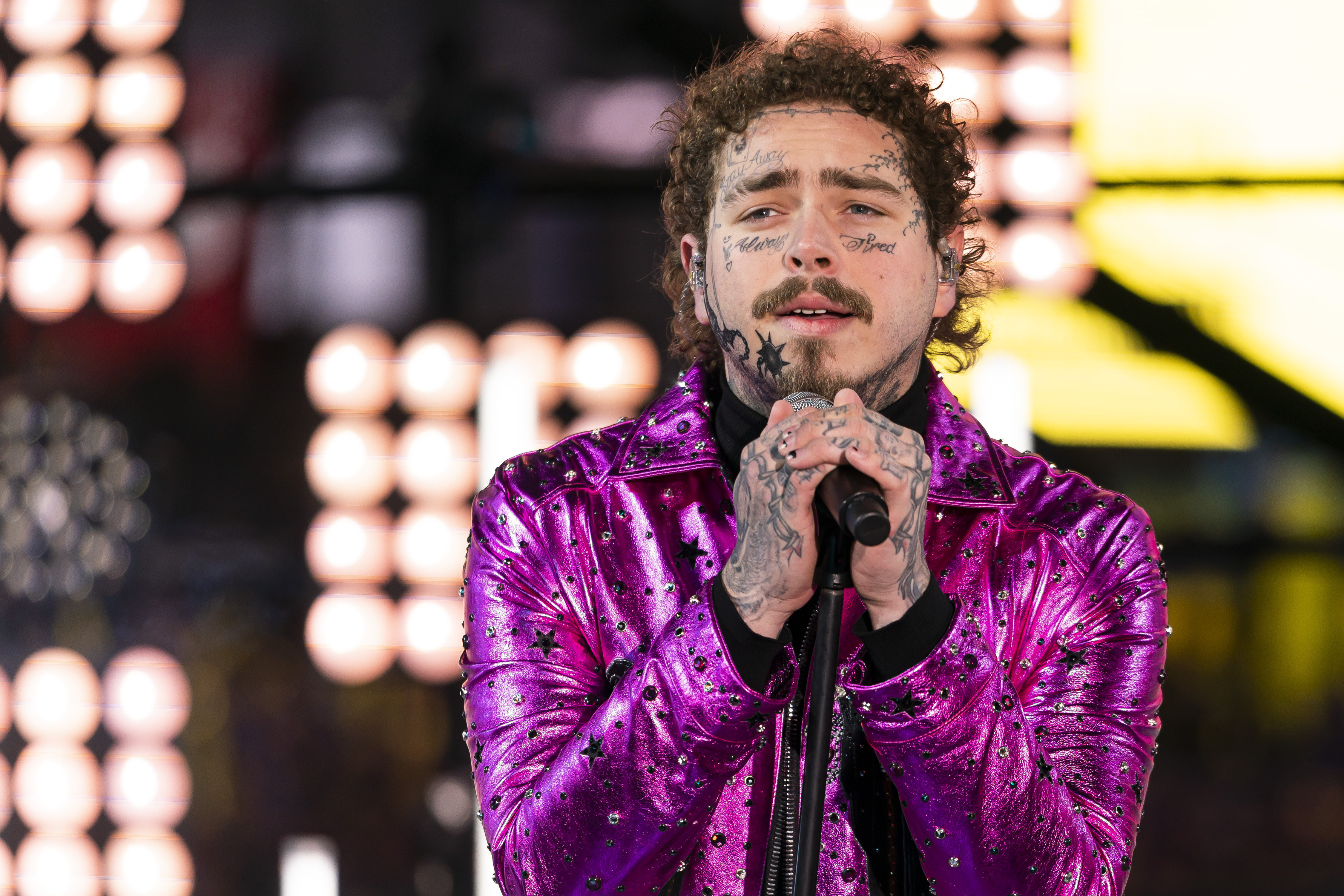 This Tuesday, Dec. 31, 2019, file photo shows Post Malone performing at the Times Square New Year's Eve celebration in New York. Post Malone is the sunflower of the 2020 Billboard Music Awards. The multi-platinum 25-year-old star scored 16 nominations, dick clark productions and NBC announced Tuesday, Sept. 22, 2020. Malone's nominations include top artist, top male artist, top rap artist and top streaming songs artist.