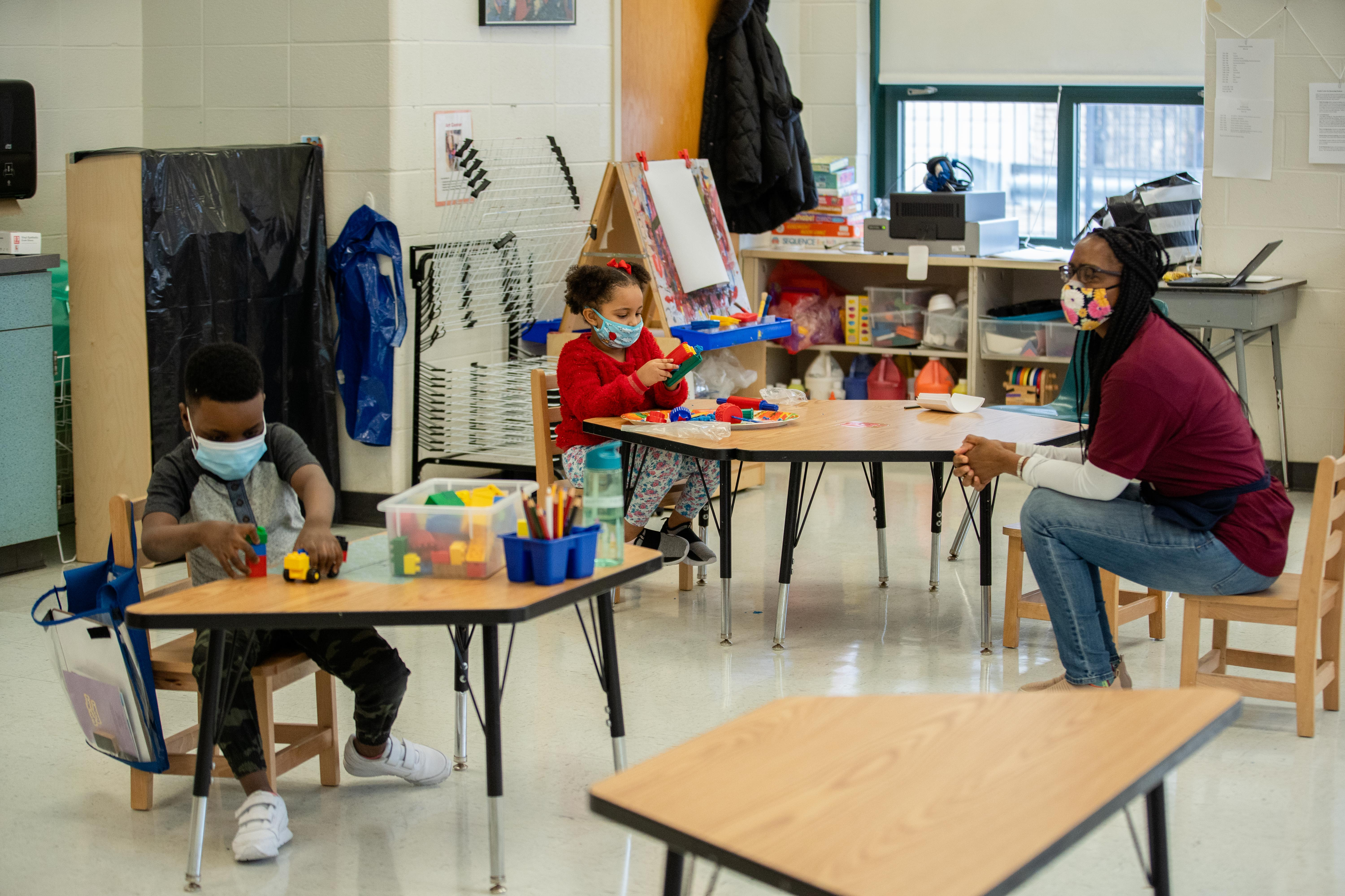 Students attend a class at Jordan Community Elementary School in the Rogers Park neighborhood, Friday morning, Jan. 15, 2021. Nineteen out of 58 pre-k students at Jordan Community Elementary School are participating in in-person learning, according to Principal Gilberto Piedrahíta.