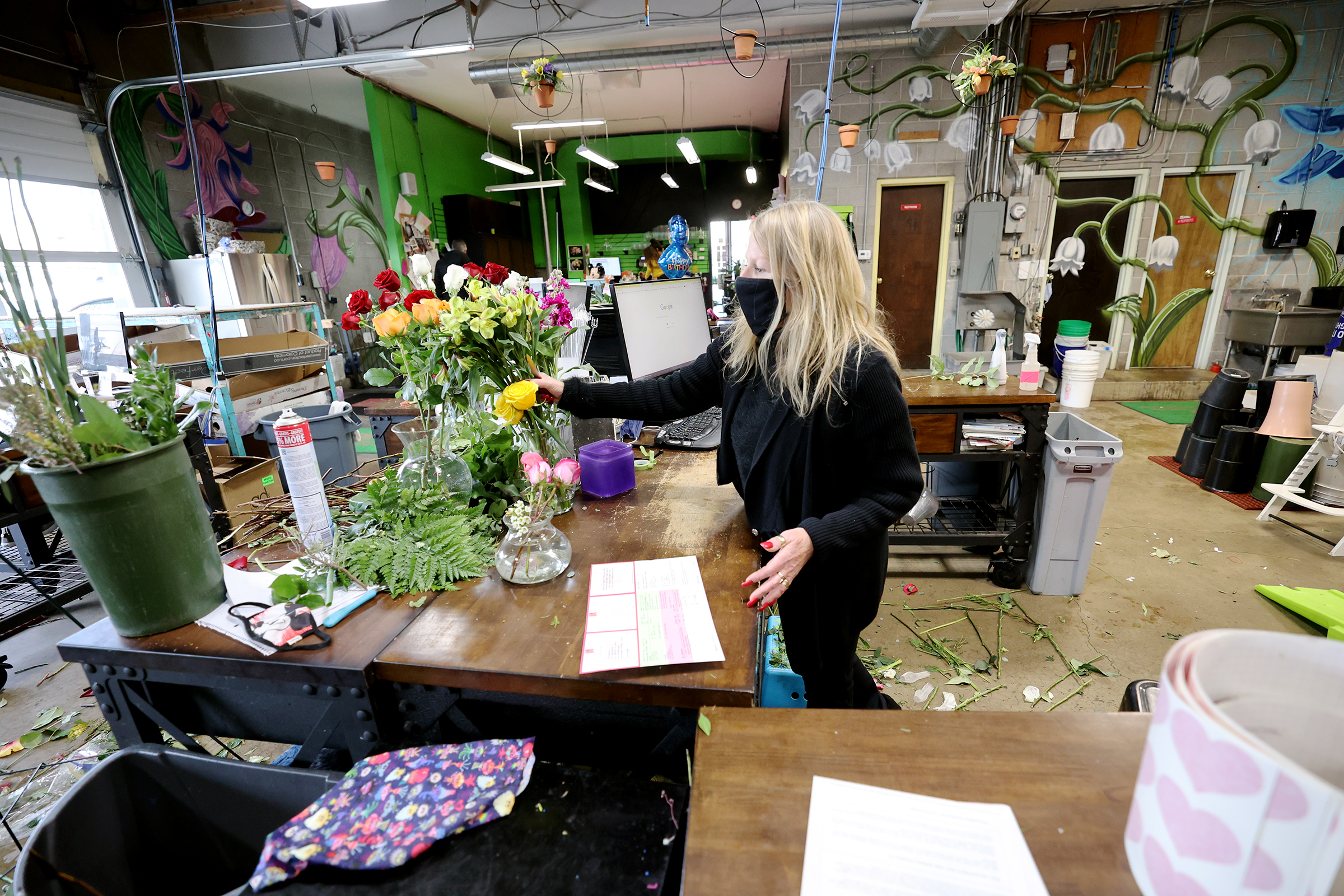Marci Rasmussen, owner of Especially For You Your Downtown Florist, works on a floral arrangementat her shop in Salt Lake City on Tuesday, Jan. 12, 2021. Rasmussen applied for Paycheck Protection Program funding during the first round of stimulus last year to keep her business afloat and will also apply for the latest round of funding.
