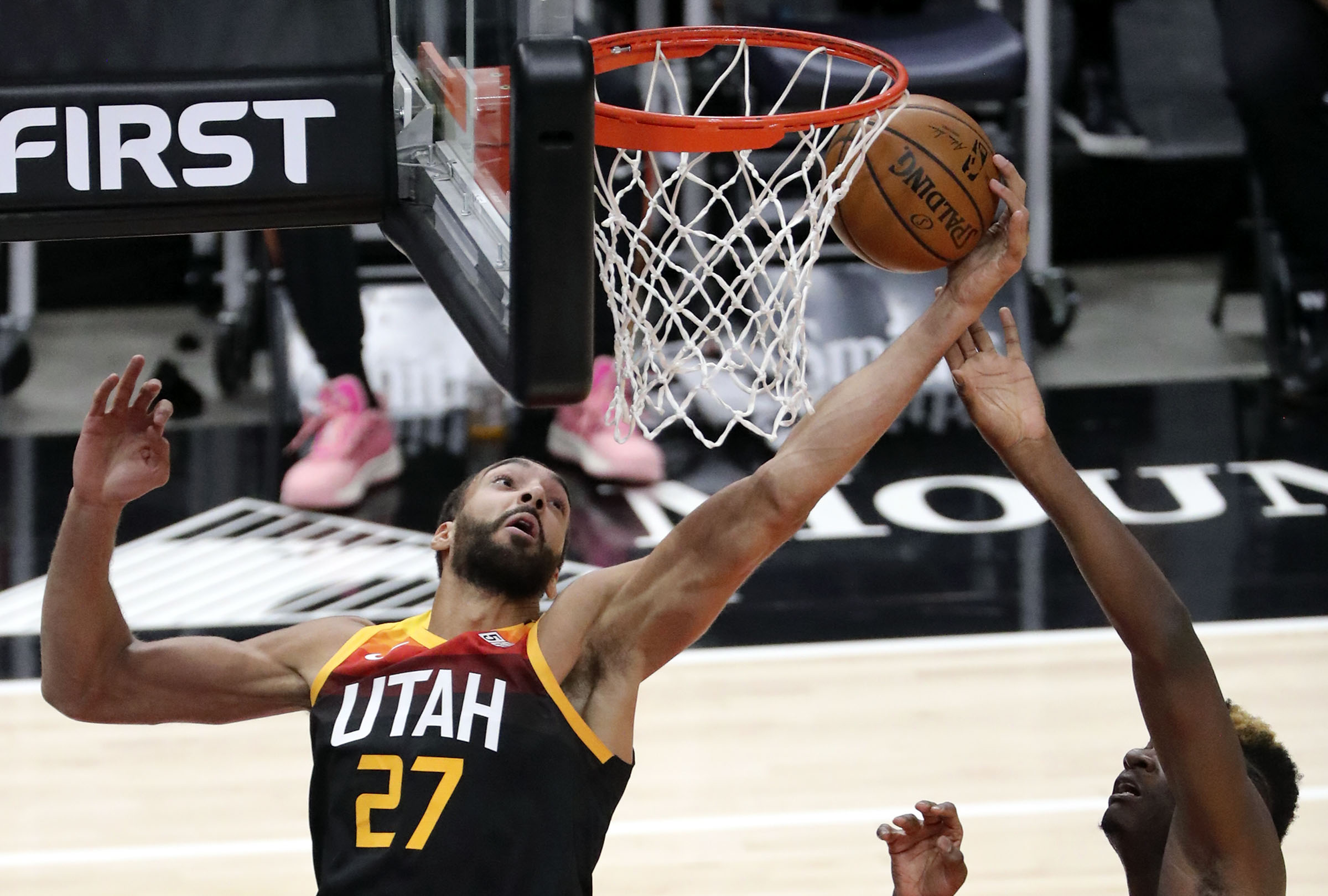 Utah Jazz center Rudy Gobert (27) and Atlanta Hawks center Clint Capela (15) reach for the rebound during an NBA game at Vivint Smart Home Arena in Salt Lake City on Friday, Jan. 15, 2021.