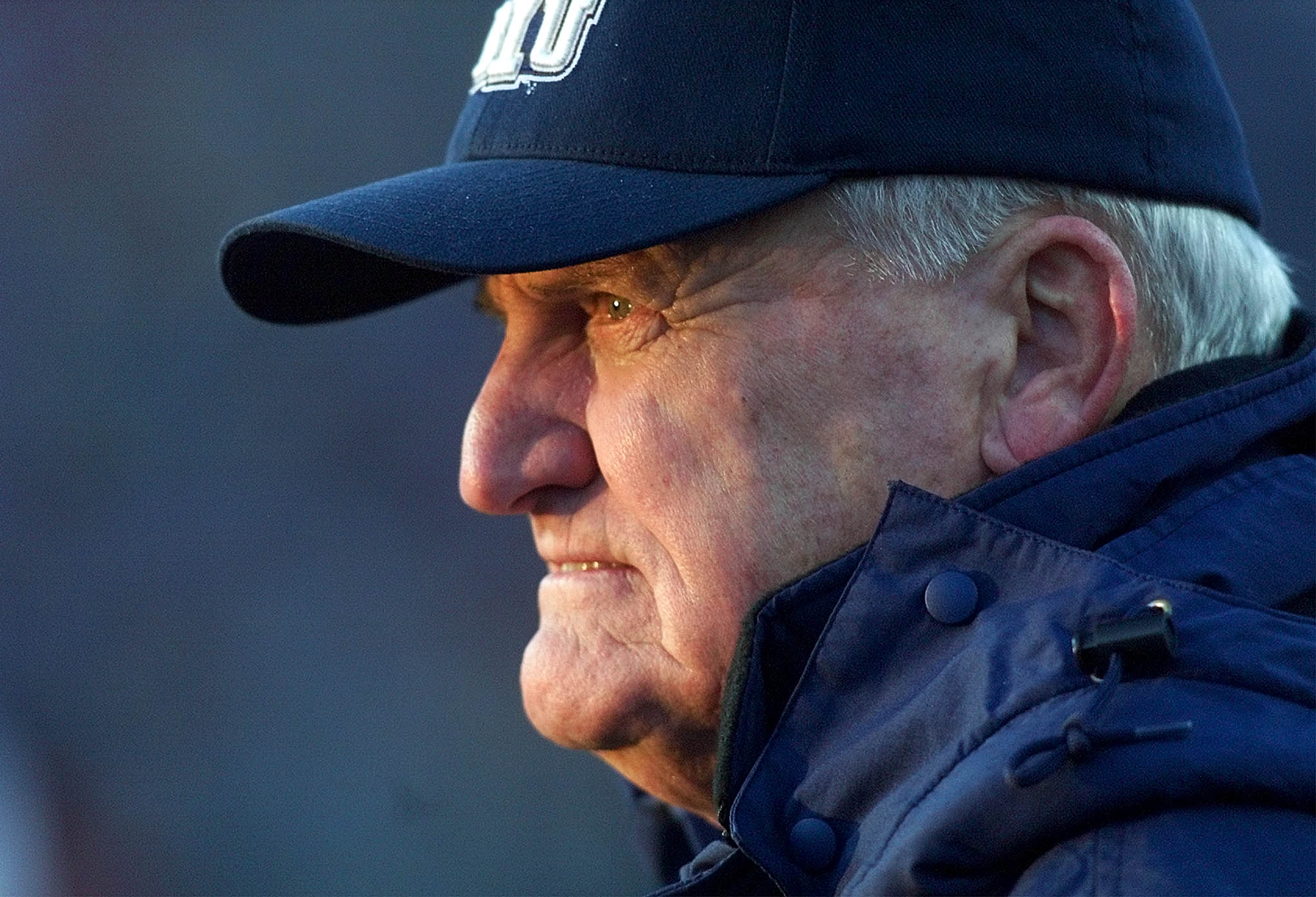 BYU Coach LaVell Edwards watches his team as the sun sets in his eyes during his final game at Cougar (now LaVell Edwards Stadium) last Saturday, Nov. 18, 2000.