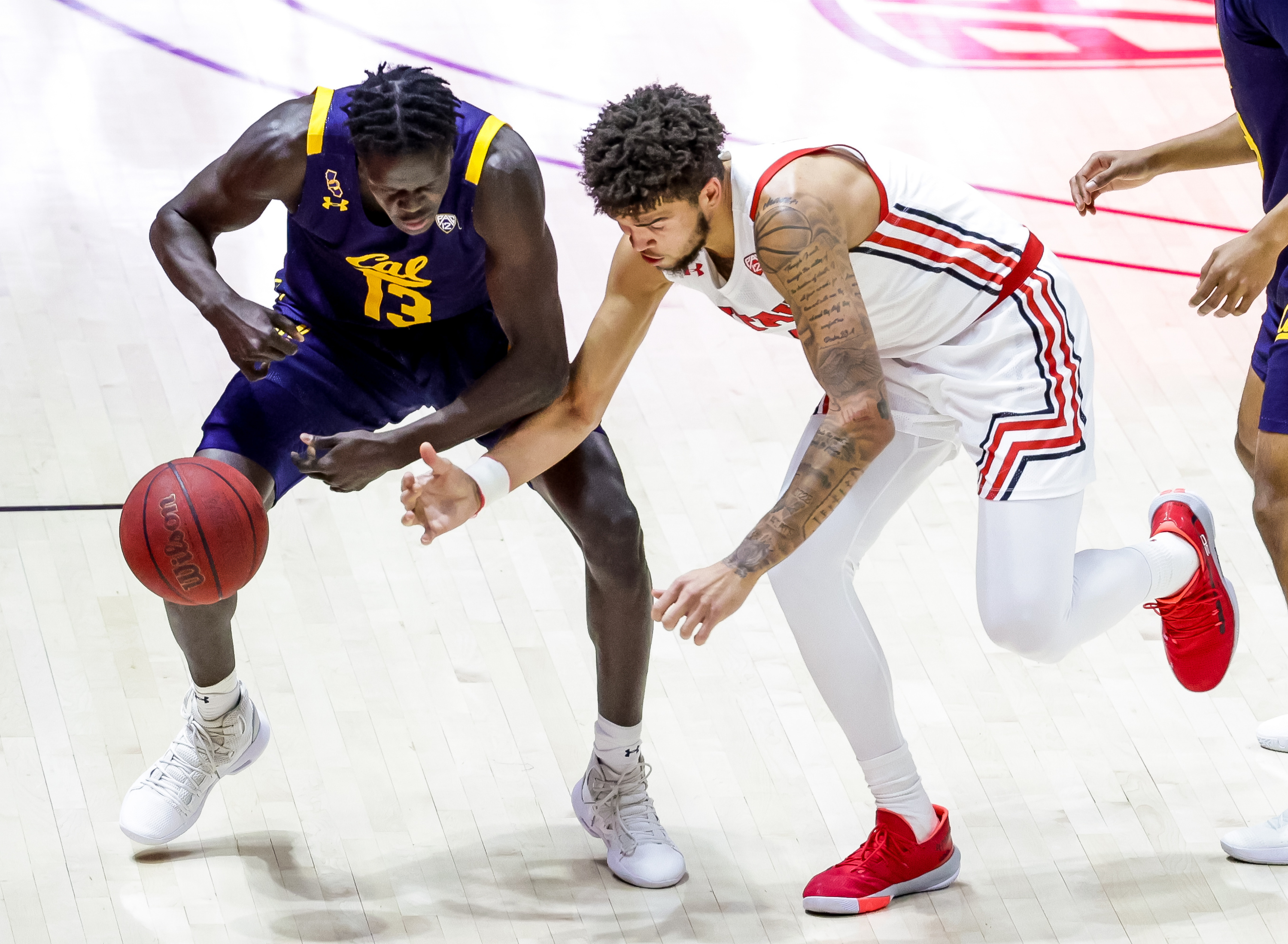Utah Utes forward Timmy Allen (1) knocks the ball from California Golden Bears forward Kuany Kuany (13) during the game at the Huntsman Center in Salt Lake City on Saturday, Jan. 16, 2021.