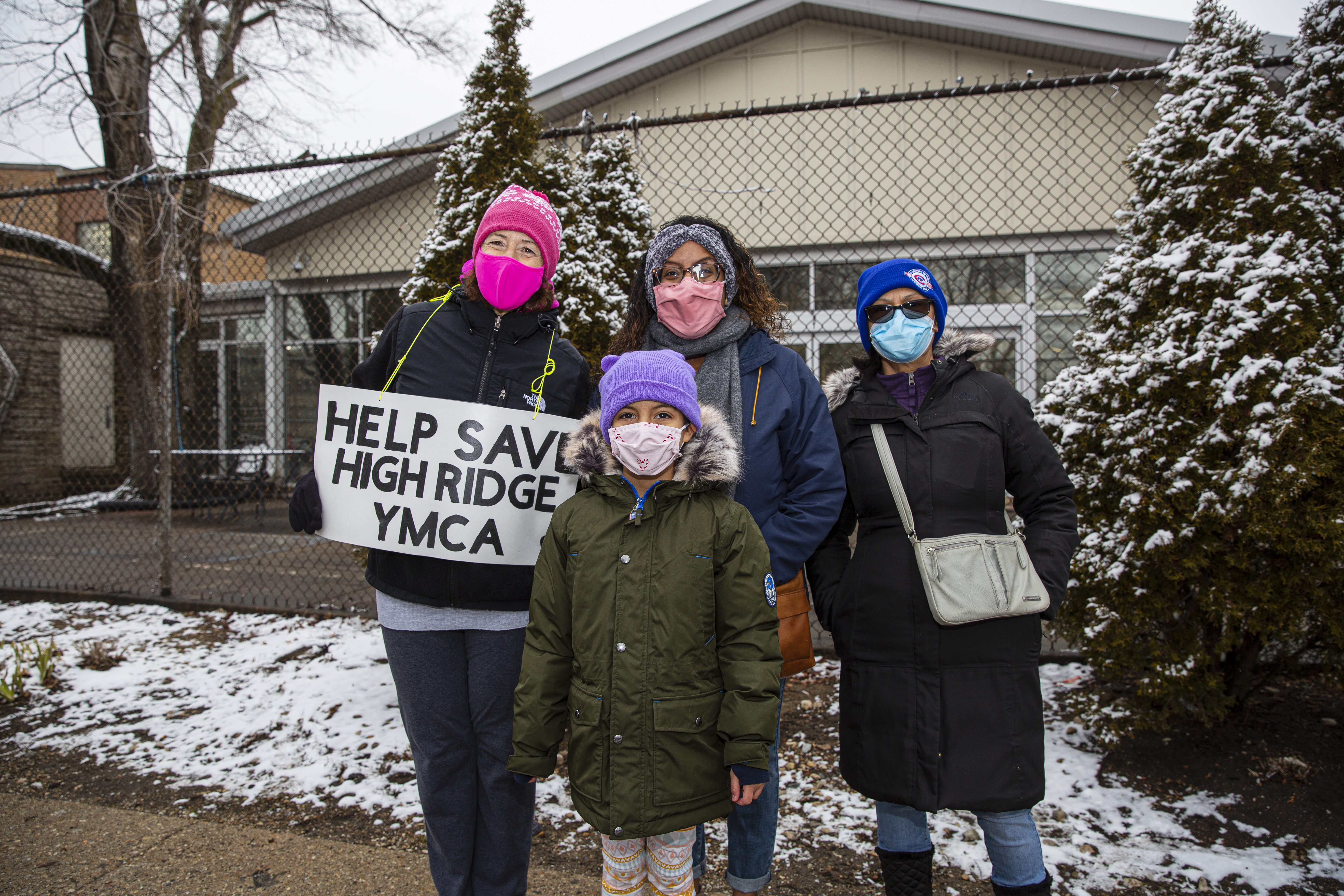 From left to right, Laurie Sneed, Reyna Walk-Faust, Rogelia Guerrero protest the closure of the High Ridge YMCA at 2424 W. Touhy Ave. in West Rogers Park. , Sunday, Jan. 17, 2021.