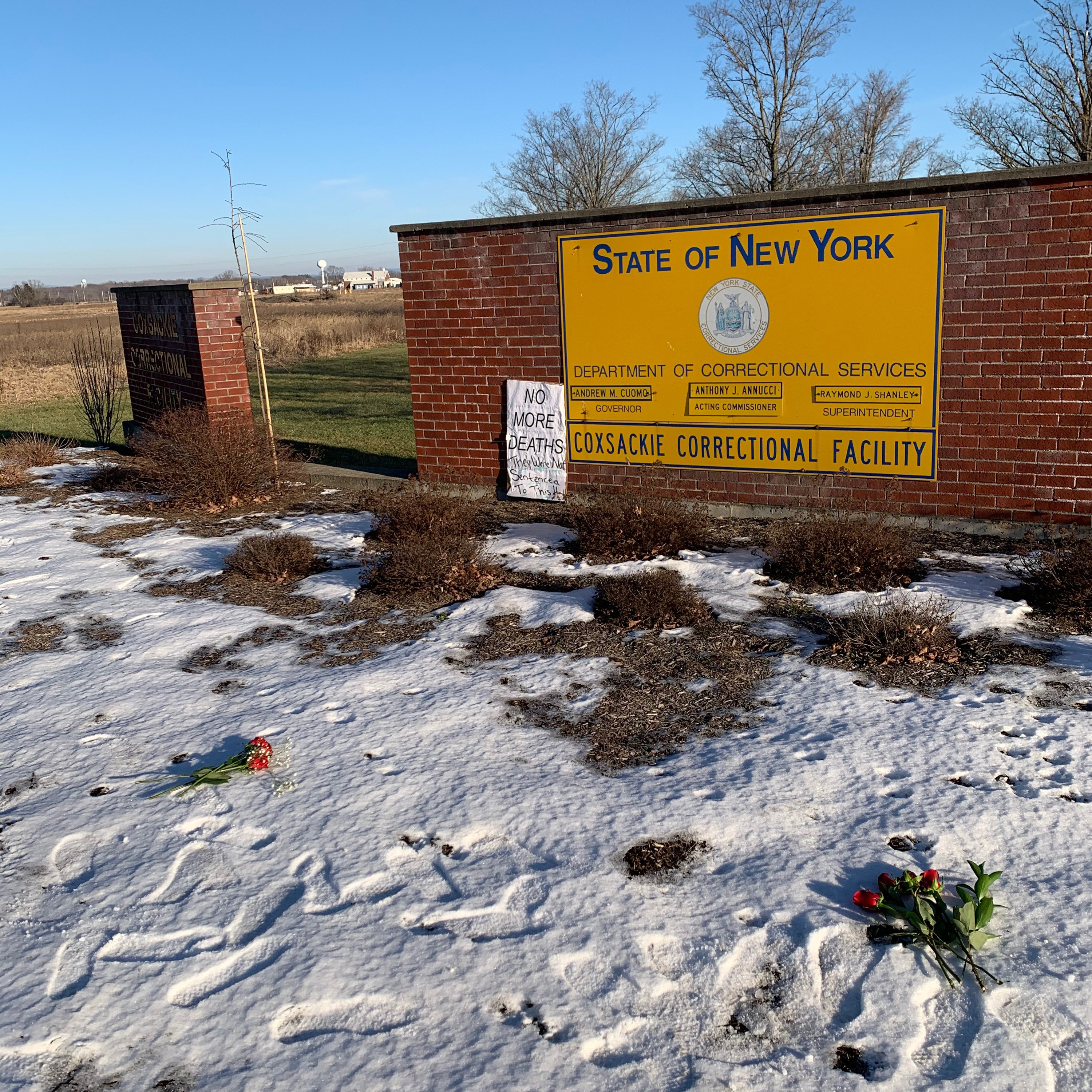 Prison reform advocates laid flowers for the dead outside Coxsackie Correctional Facility, Jan. 10, 2020.