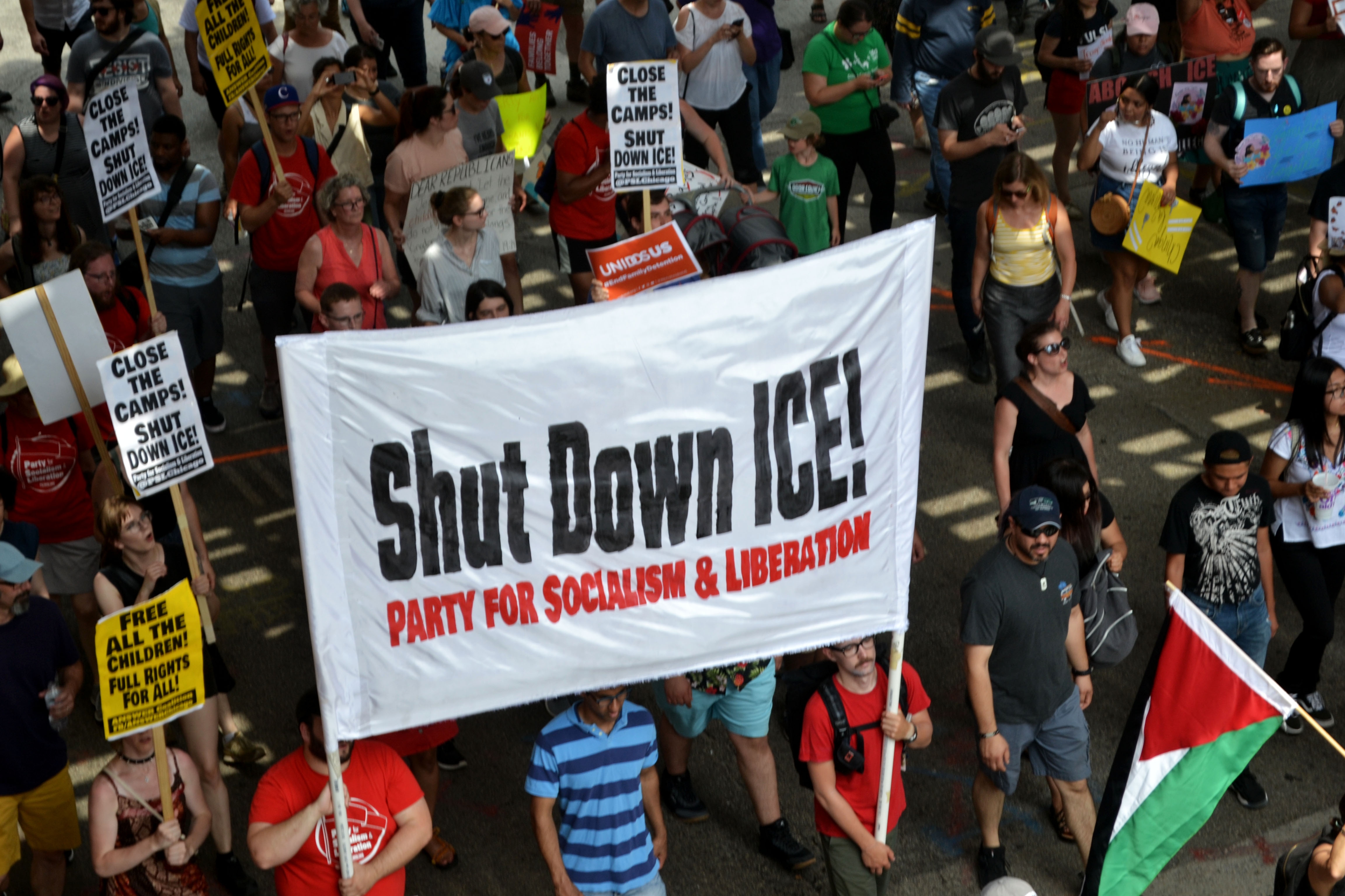 Protesters march down Clark Street onSaturday, July 13, 2019 to protest anticipated raids by immigration officials.