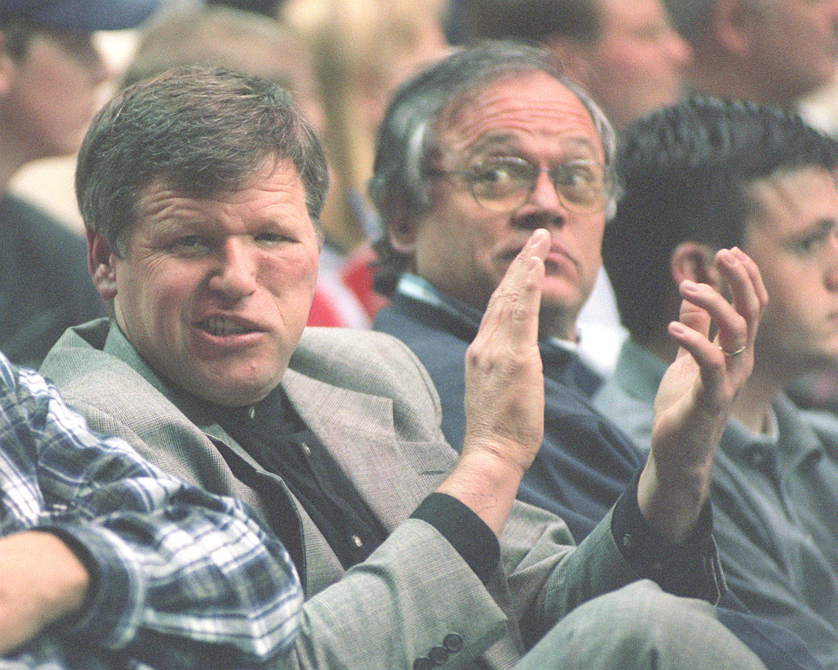 01.15.98 - Last year's interim coach Tony Ingle takes in the BYU game against Wyoming. PHOTO BY GARY MCKELLAR.