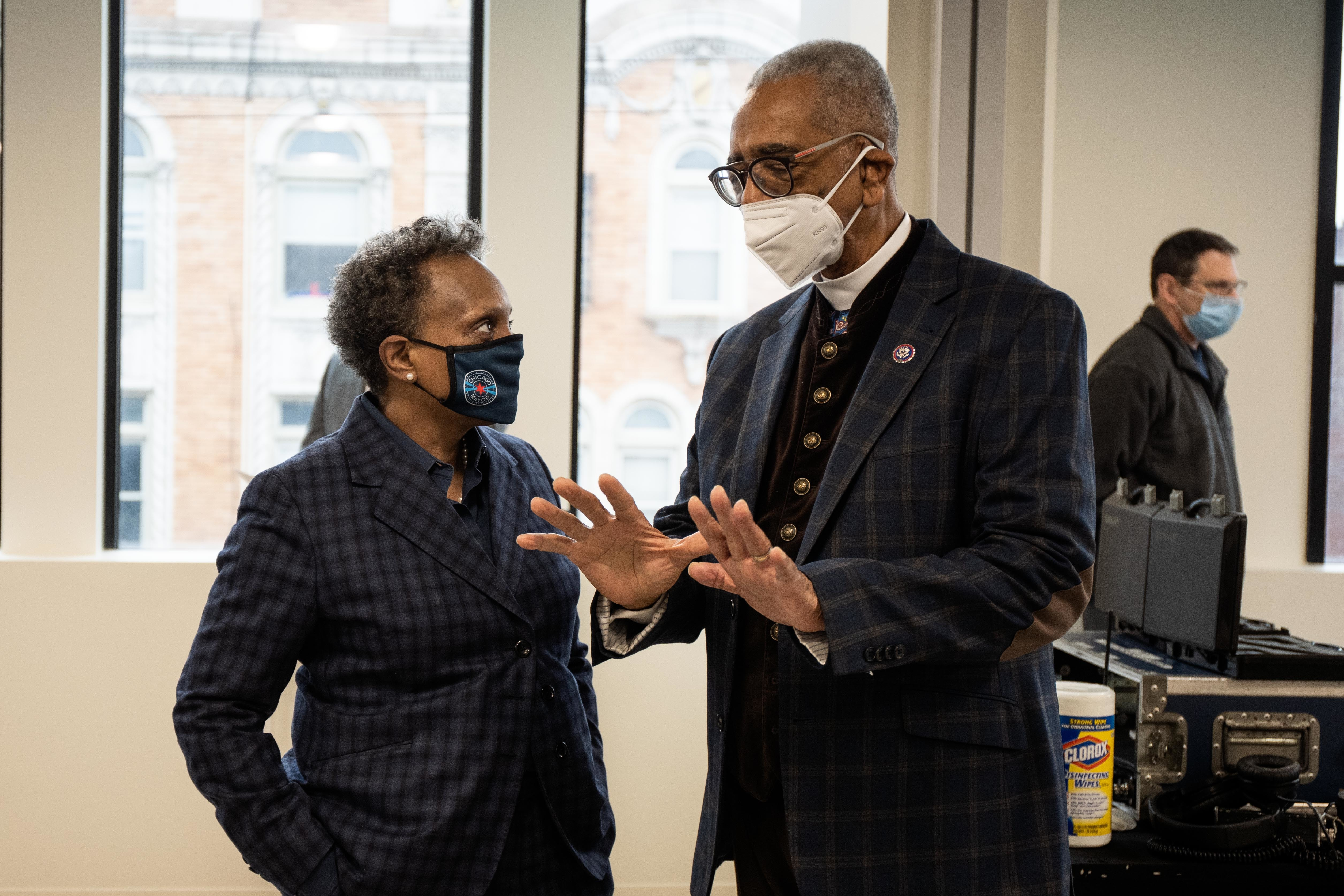 Chicago Mayor Lori Lightfoot speaks to U.S. Rep. Bobby Rush at the opening of the Chatham Education and Workforce Center Tuesday morning, Jan. 19, 2021.
