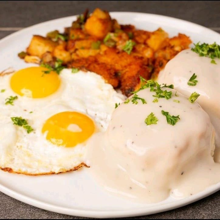 Biscuits and gravy with two eggs at Black & Blue Diner