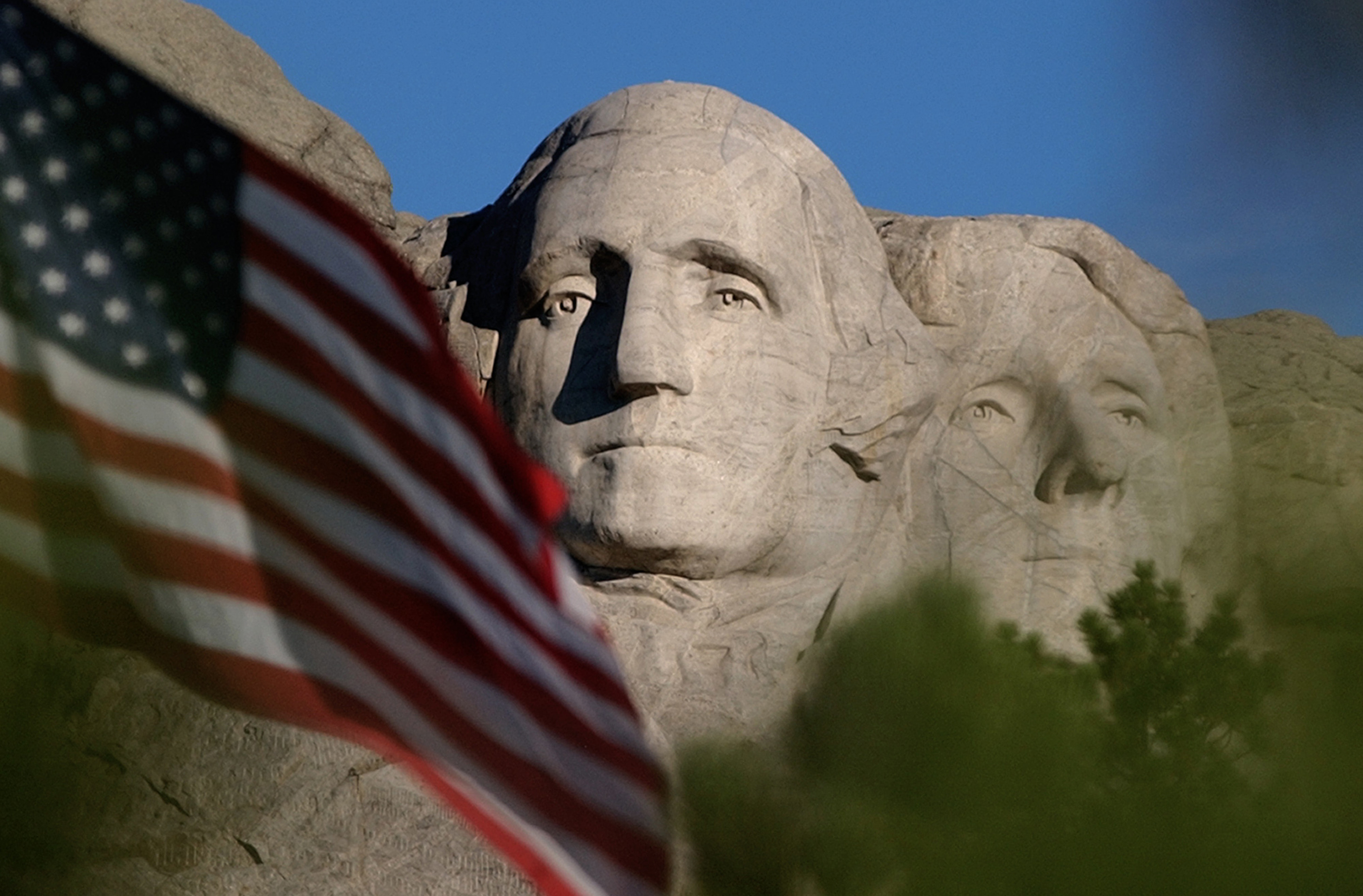 In this Sept. 11, 2002, file photo, the sun rises on Mt. Rushmore National Memorial near Keystone, S.D. as the flag is flown at half staff in honor of the first anniversary of the Sept. 11 terrorist attacks against the United States.