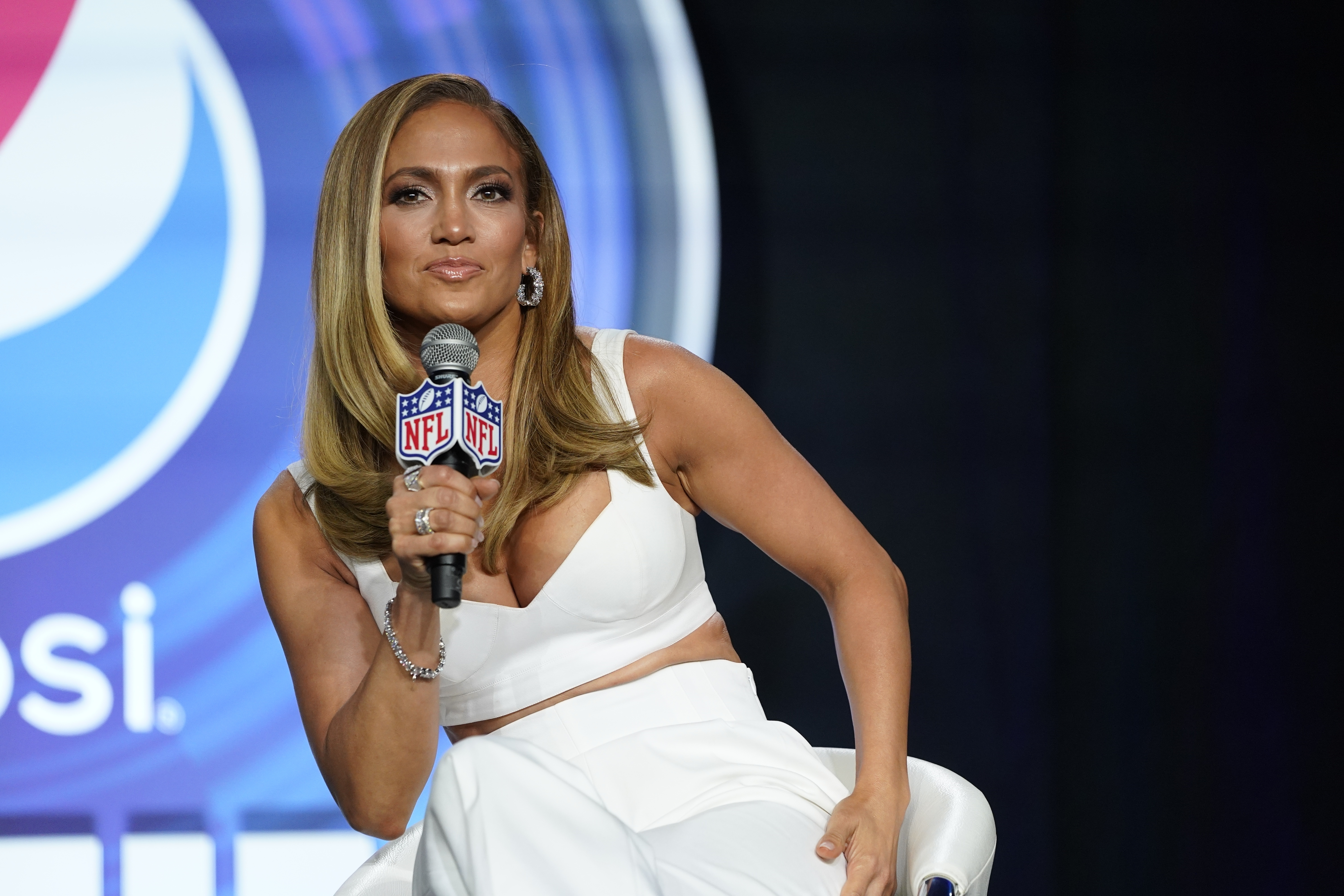 In this Jan. 30, 2020 file photo, NFL Super Bowl 54 football game halftime performer Jennifer Lopez answers questions at a news conference in Miami.