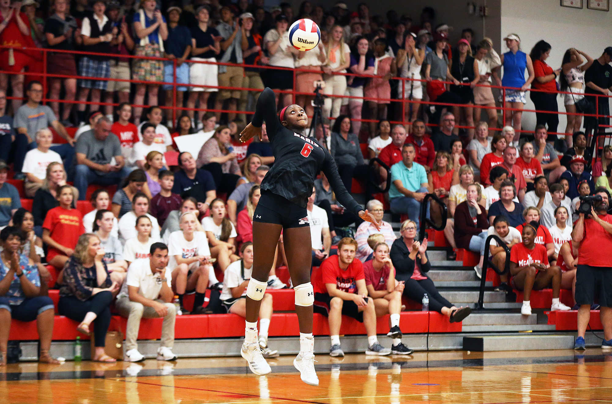Marist's Camryn Hannah serves against Mother McAuley in 2018.