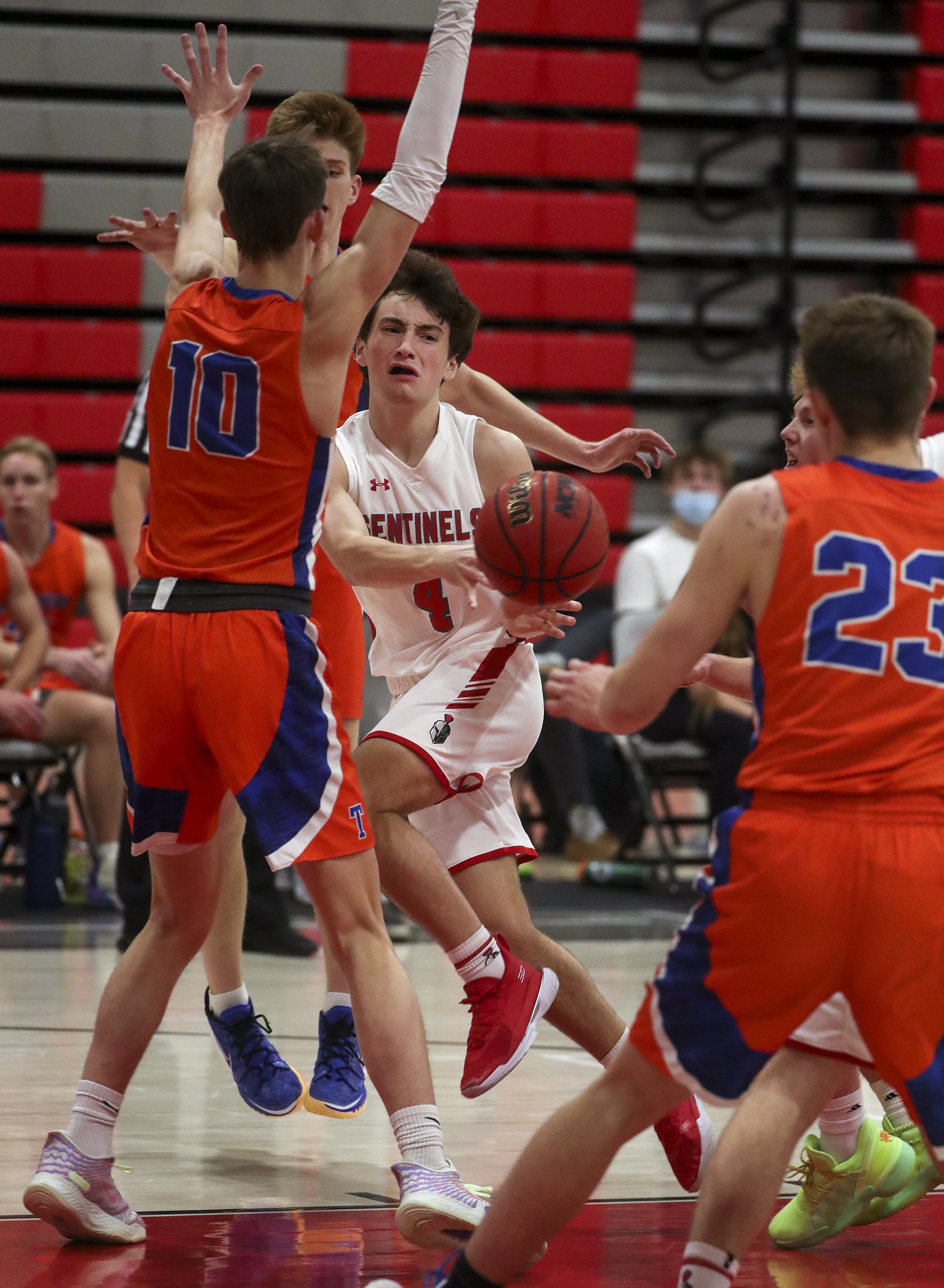Mountain Ridge guard Kyle Carley passes around the defense of Timpview forward Jake Wahlin during a basketball game at Mountain Ridge High School in Herriman on Tuesday, Jan. 19, 2021.