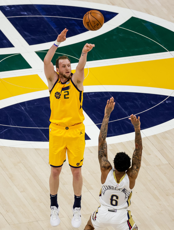 Utah Jazz forward Joe Ingles (2) shoots over New Orleans Pelicans guard Nickeil Alexander-Walker (6) at Vivint Smart Home Arena in Salt Lake City on Tuesday, Jan. 19, 2021.