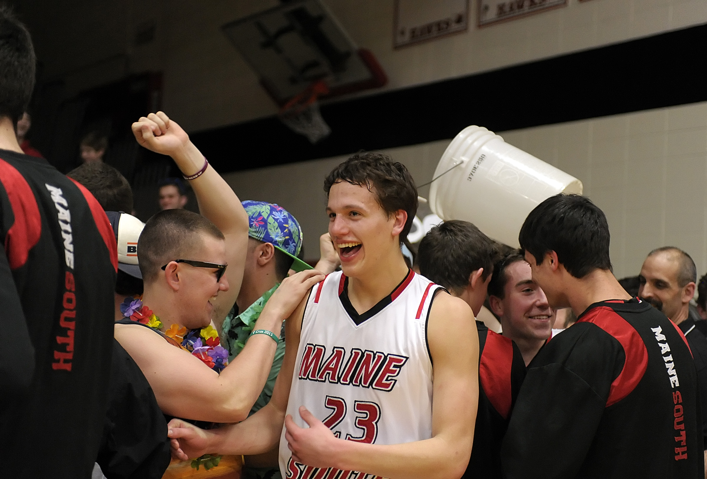 Maine South's Andrew Palucki celebrates with the fans after the Hawks defeated Evanston 74-66 (OT) in the Class 4A Maine South Sectional in 2014.