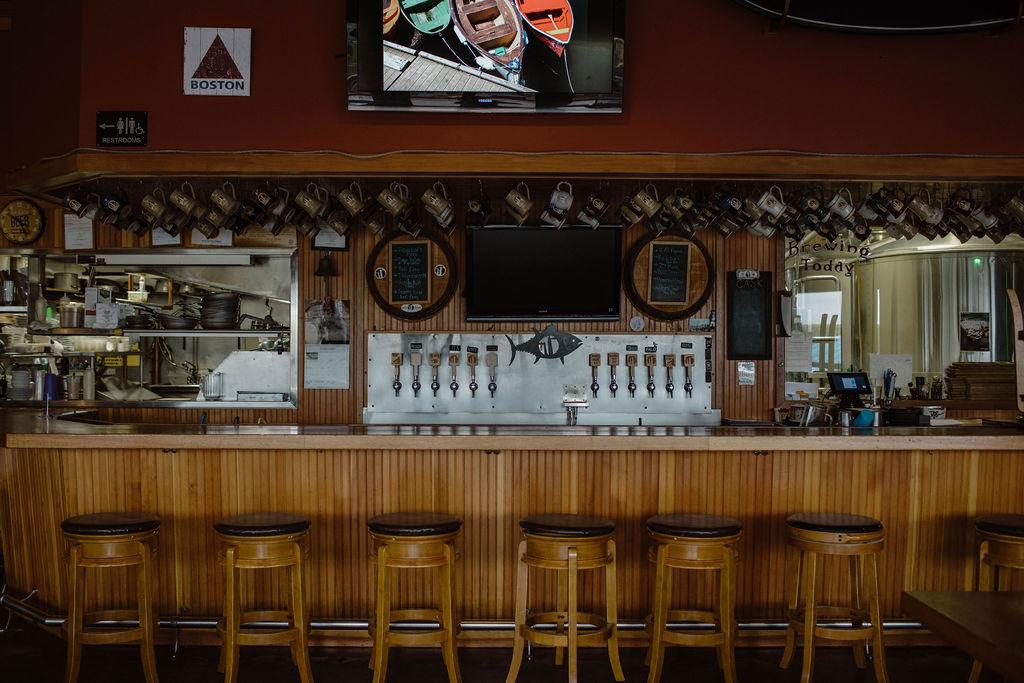 An empty bar decorated with Boston sports memorabilia