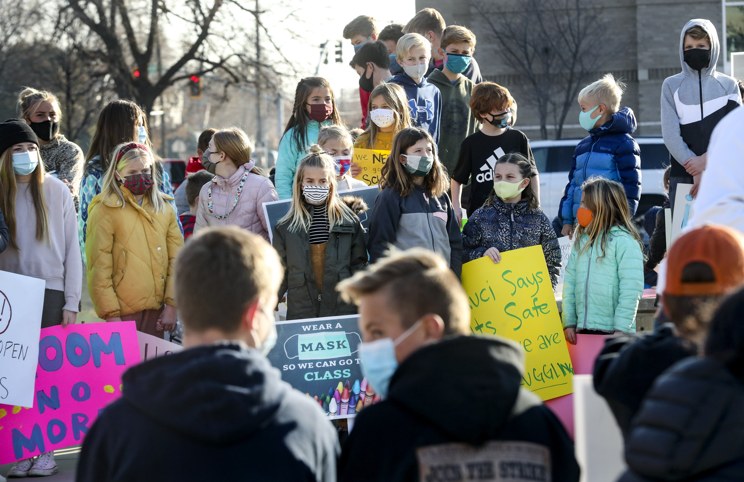 Salt Lake City School District students of all ages rally in favor of attending school in person outside of East High School in Salt Lake City on Monday, Dec. 7, 2020.