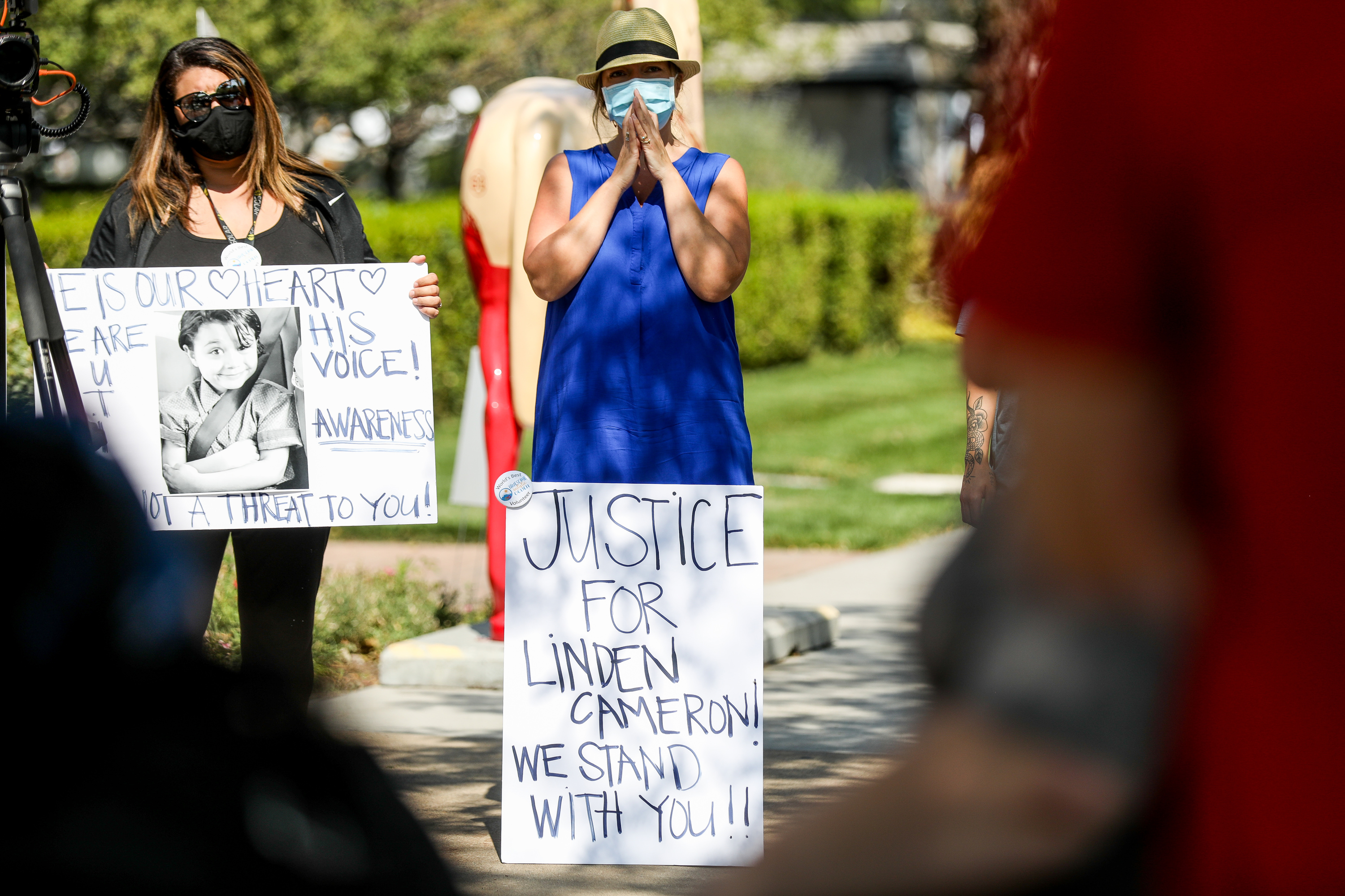 Amanda Funk and Lisa Hamby attend a rally outside the Ogden Municipal Building in Ogden on Saturday, Sept. 12, 2020. People gathered to protest and call attention to the shooting of Linden Cameron, a 13-year-old with Asperger's syndrome who was shot by police in Salt Lake City.