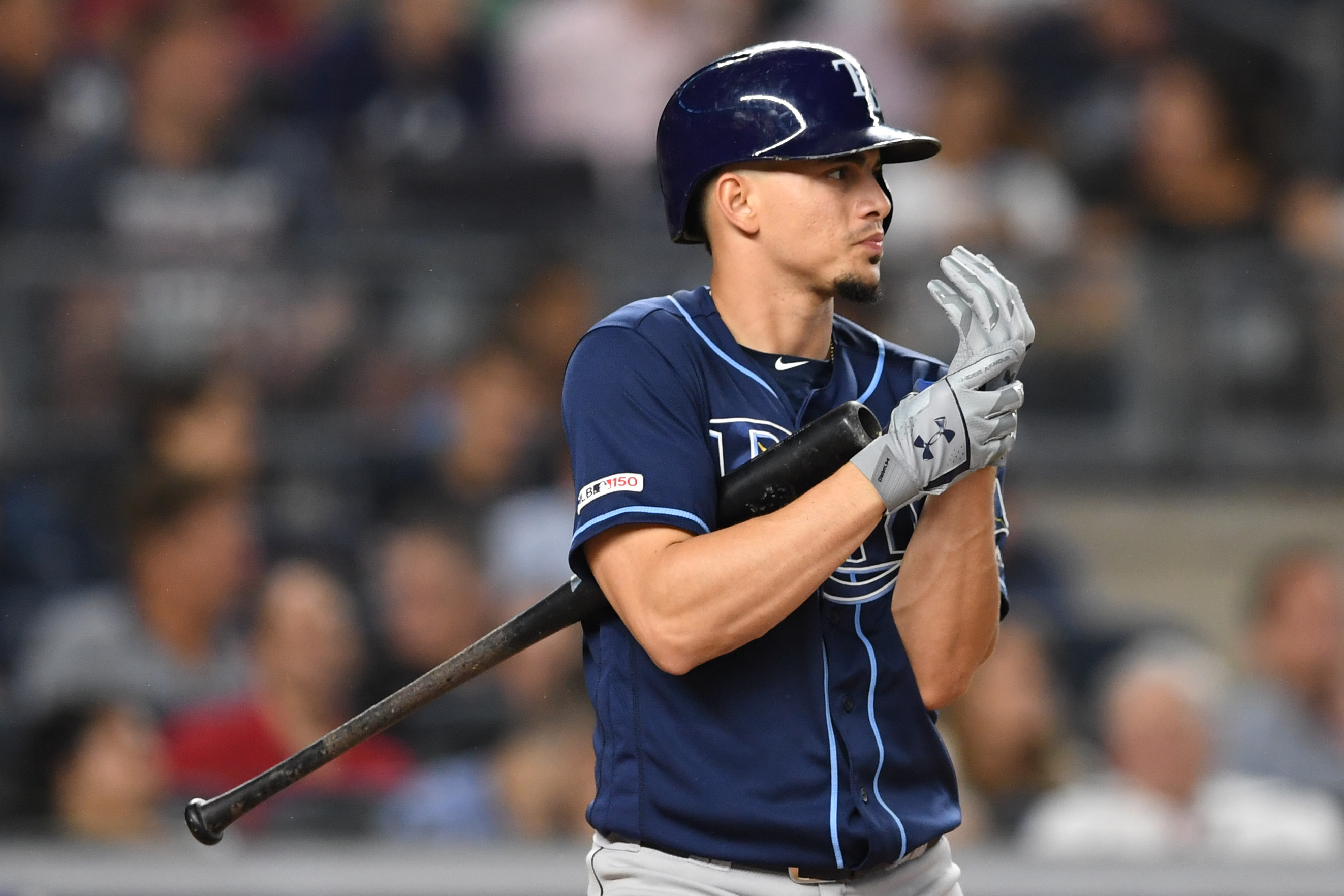 Willy Adames #1 of the Tampa Bay Rays adjusts his gloves during his at-bat during the third inning of game two of a doubleheader against the Tampa Bay Rays at Yankee Stadium on July 18, 2019 in the Bronx borough of New York City.