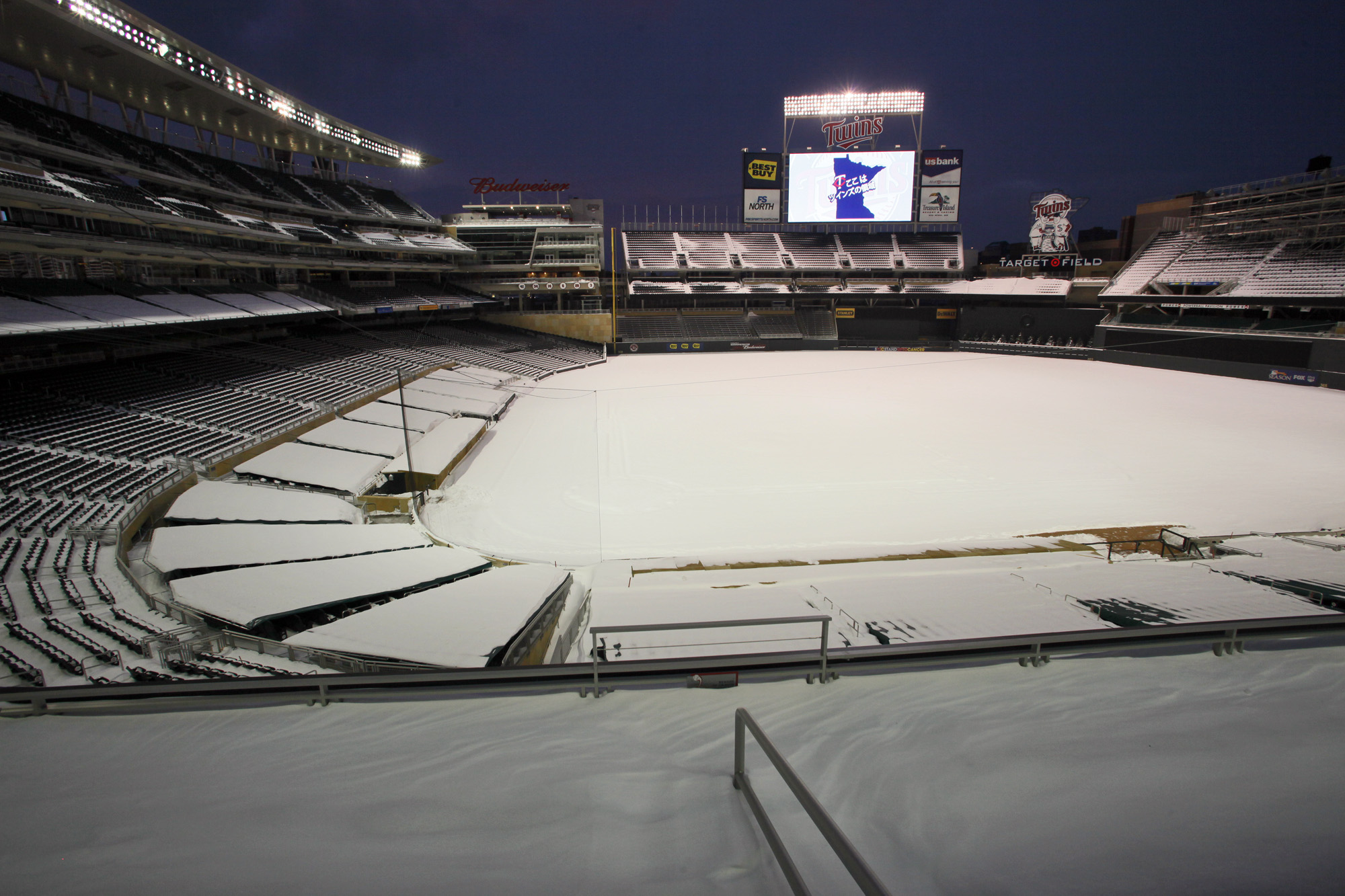 MARLIN LEVISON*mlevison@startribune.com GENERAL INFORMATION : ] Japanese baseball player Tsuyoshi Nishioka was introduced as a newly acquired Twins player during a press conference at Target Field. IN THIS PHOTO: The scoreboard in the outfield of a snow c