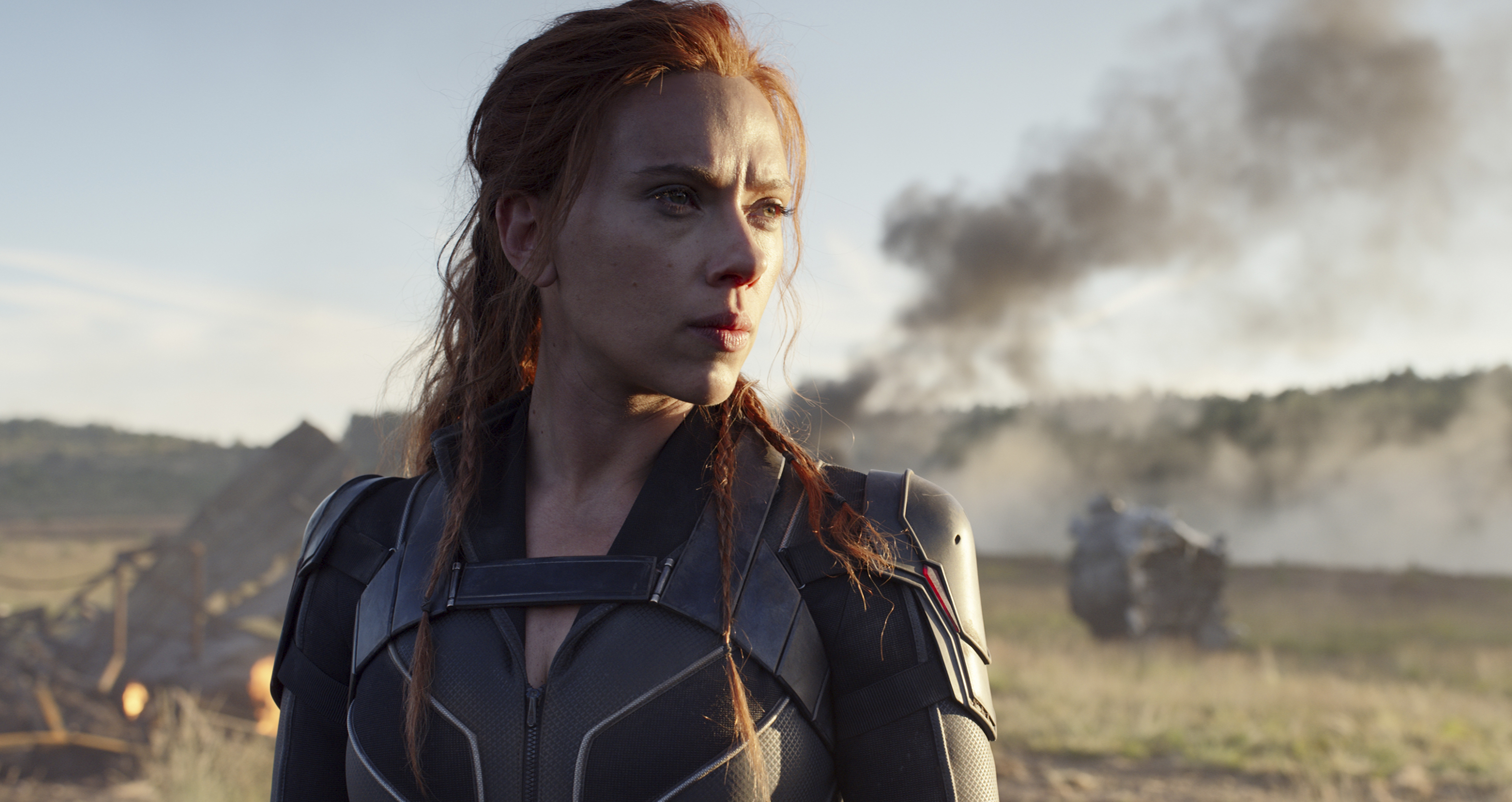 """This image released by Disney/Marvel Studios shows Scarlett Johansson in a scene from """"Black Widow,"""" which is scheduled to be released May 7."""