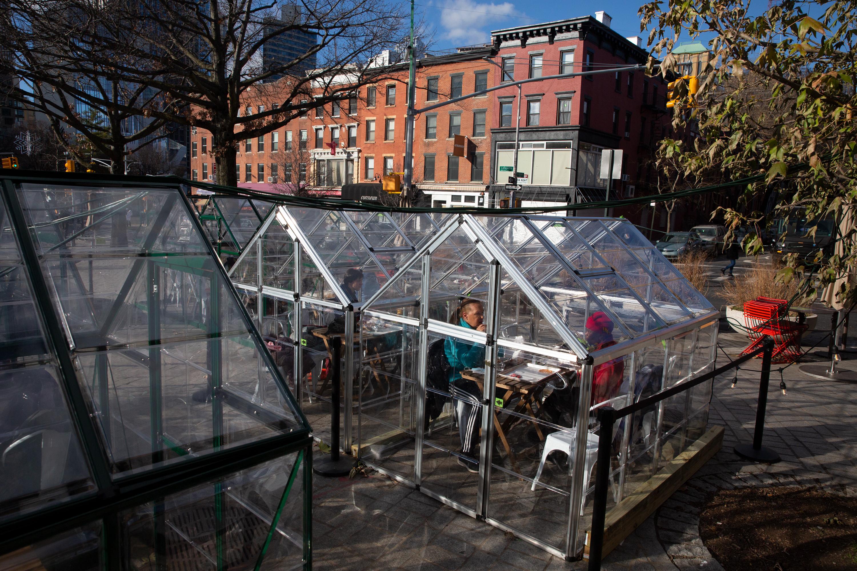 People eat outside in Fort Greene, Brooklyn during the coronavirus outbreak, Dec. 29, 2020.
