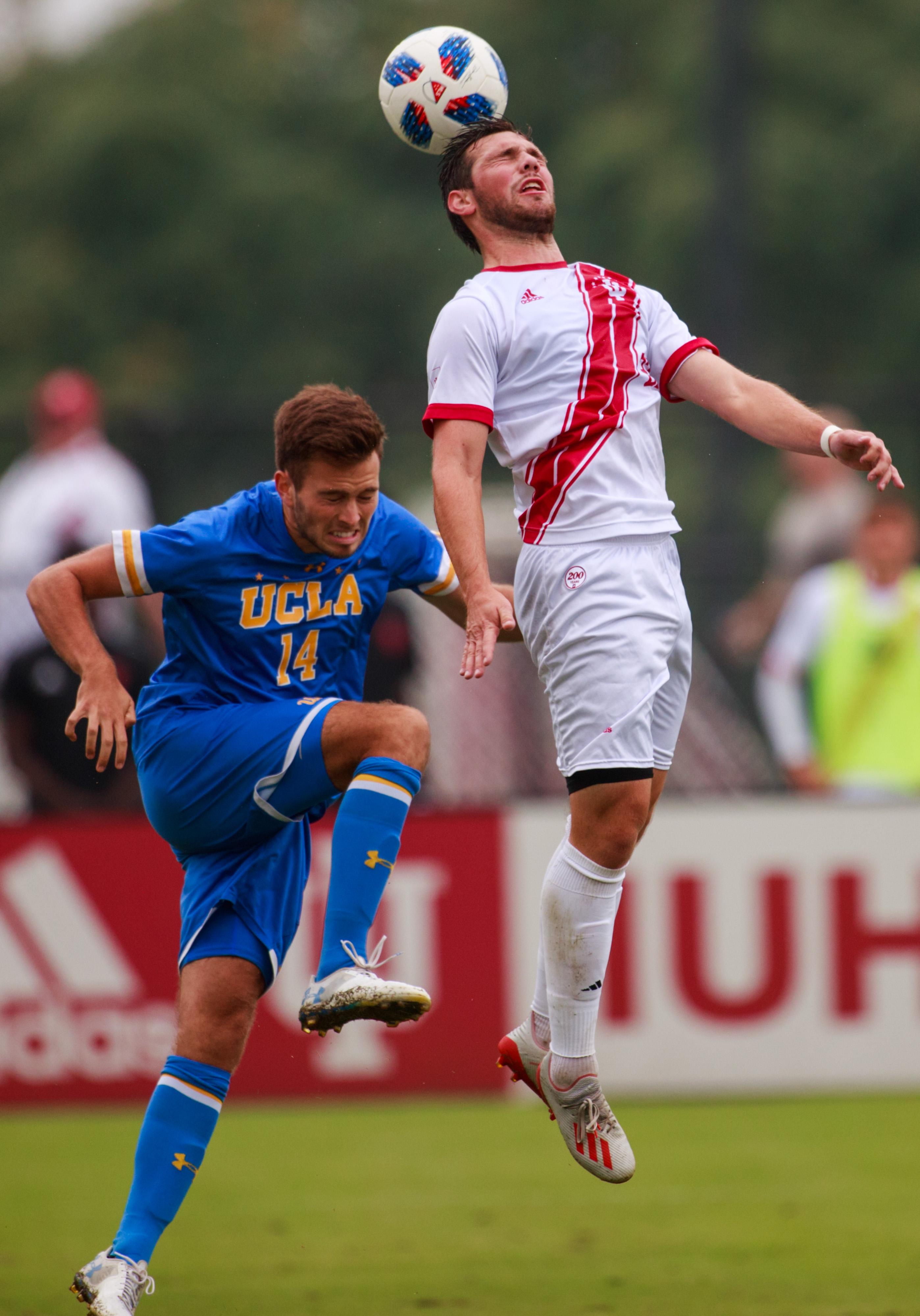Indiana University soccer player Ian Black (22) and UCLA's...
