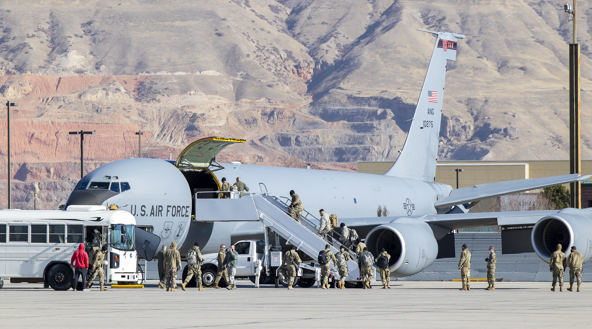 Members of the Utah National Guard board a KC-135 jet at Roland R. Wright Air National Guard Base in Salt Lake City on Friday, Jan. 15, 2021. The Guardsmen are bound for Washington, D.C., to support civil authorities during the inauguration of President-elect Joe Biden.