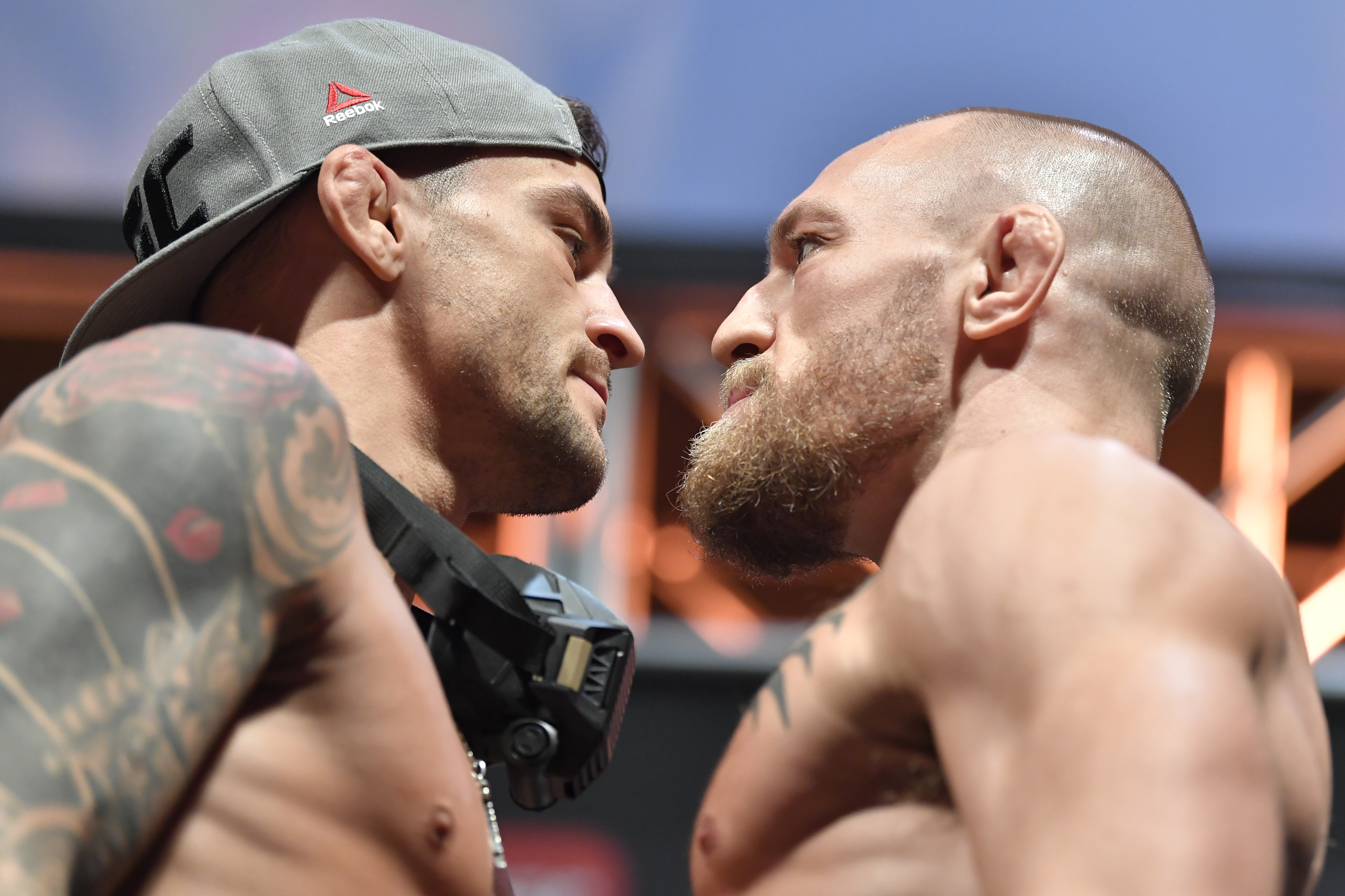 Opponents Dustin Poirier and Conor McGregor of Ireland face off during the UFC 257 weigh-in at Etihad Arena on UFC Fight Island on January 22, 2021 in Abu Dhabi, United Arab Emirates.