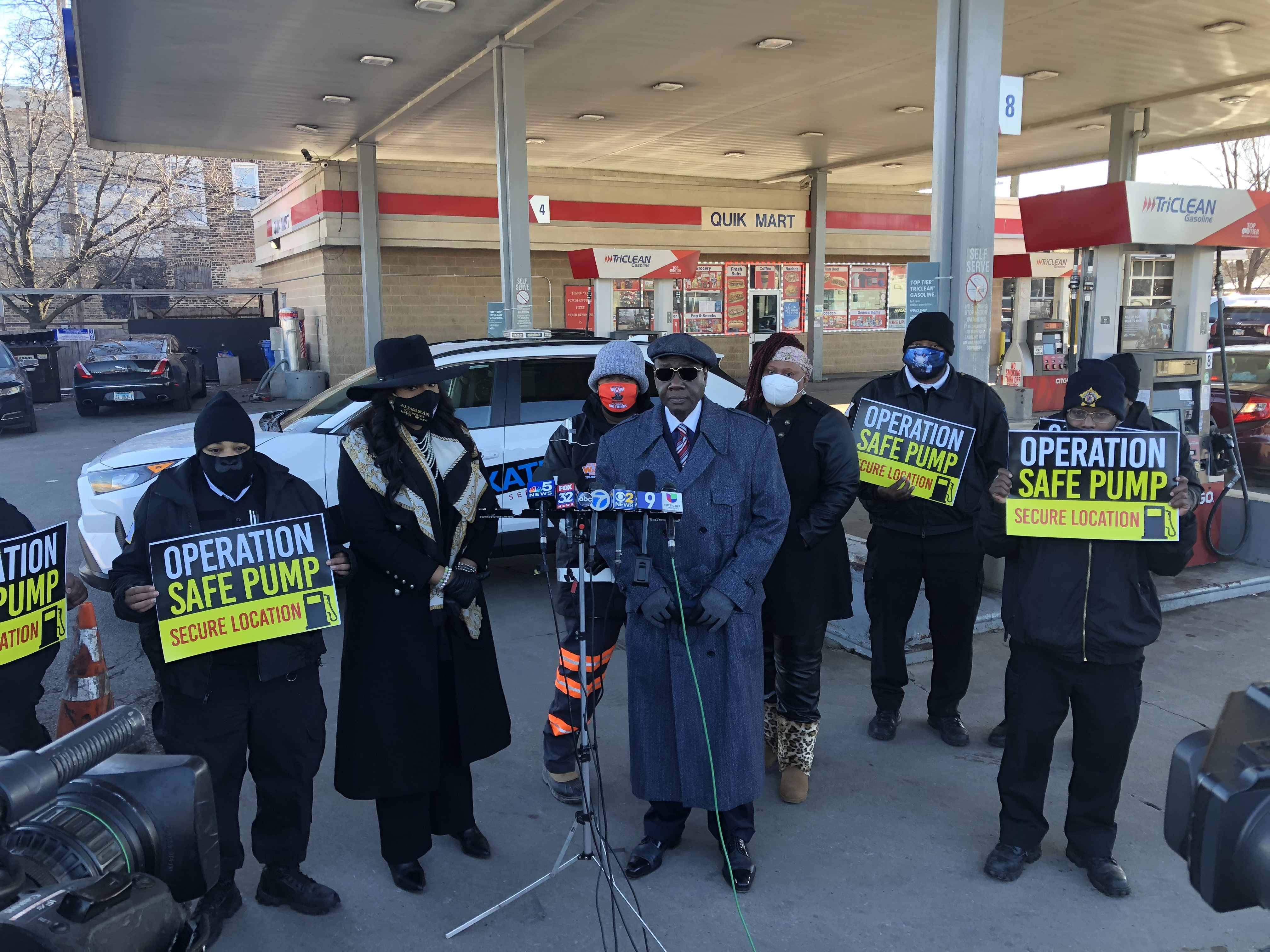 Kates Detective and Security Agency CEO William Kates (center) speaks at a news conference Friday with supporters, including Ald. Stephanie Coleman, left.