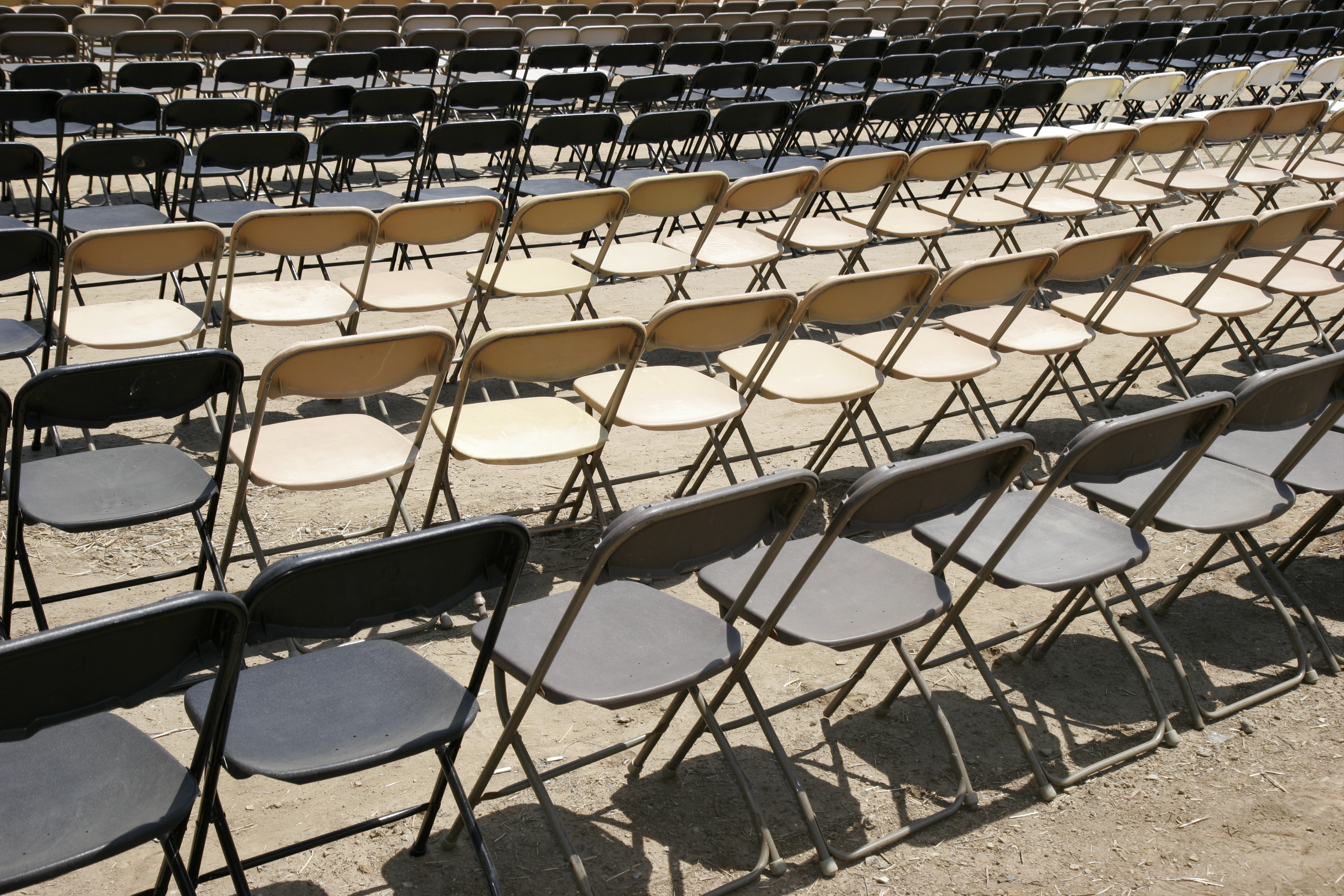 Rows of empty folding chairs at Porter County Fair.
