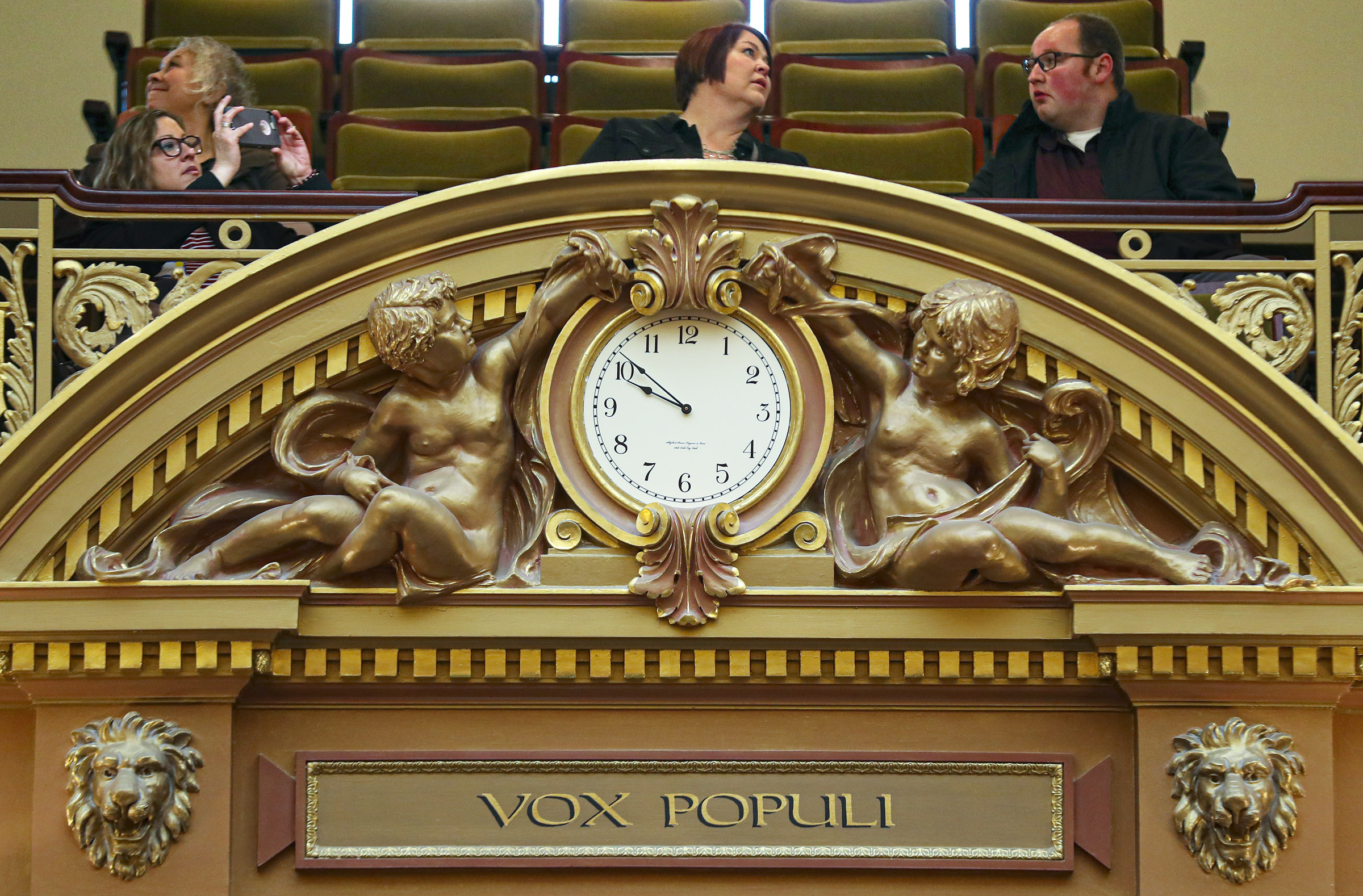 People begin to fill the gallery above the clock in the House of Representatives during a break at the Capitol in Salt Lake City on Thursday, Jan. 30, 2020.