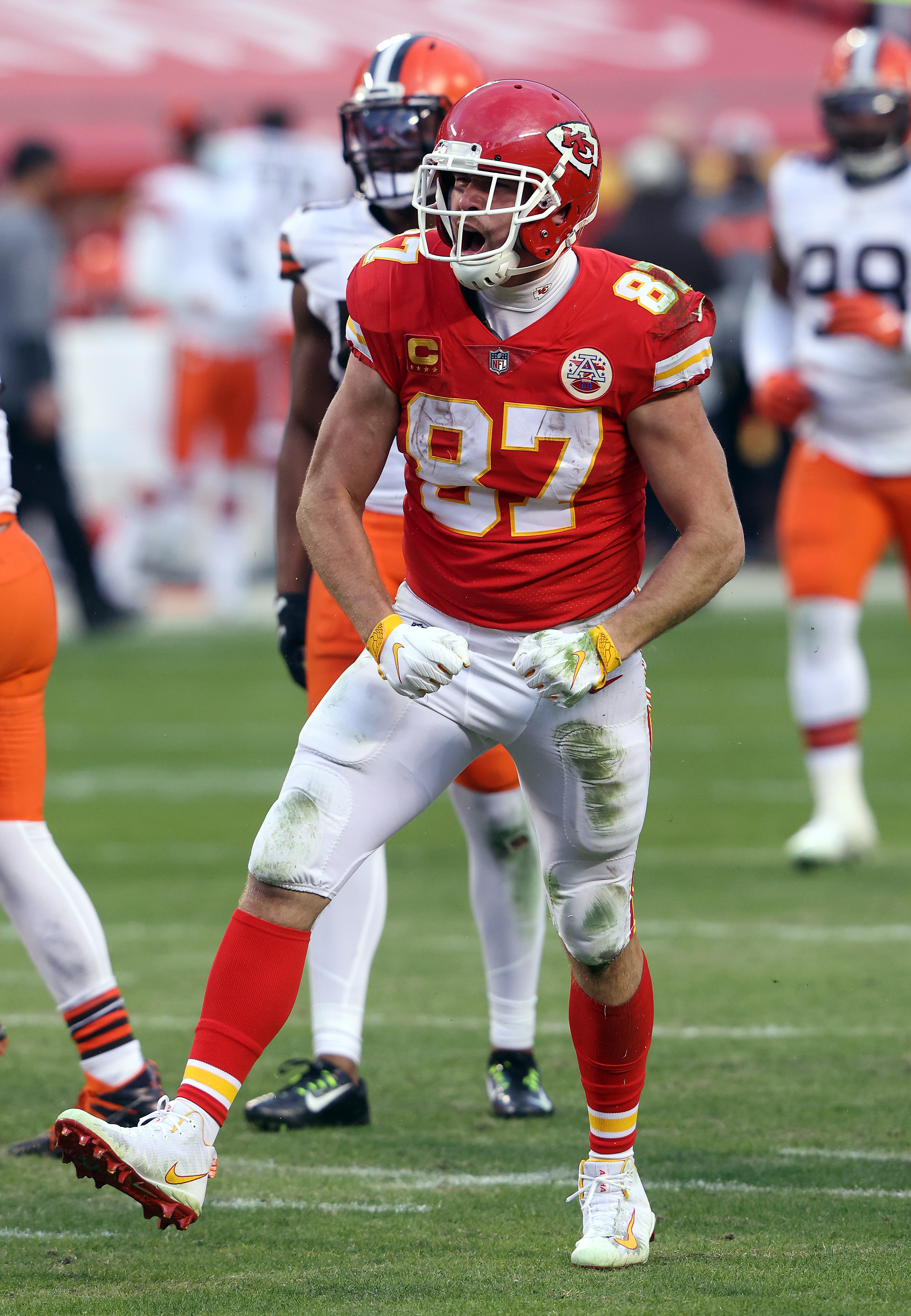 Travis Kelce #87 of the Kansas City Chiefs celebrates after making a catch for a first down over the Cleveland Browns during the fourth quarter of the AFC Divisional Playoff game at Arrowhead Stadium on January 17, 2021 in Kansas City, Missouri.