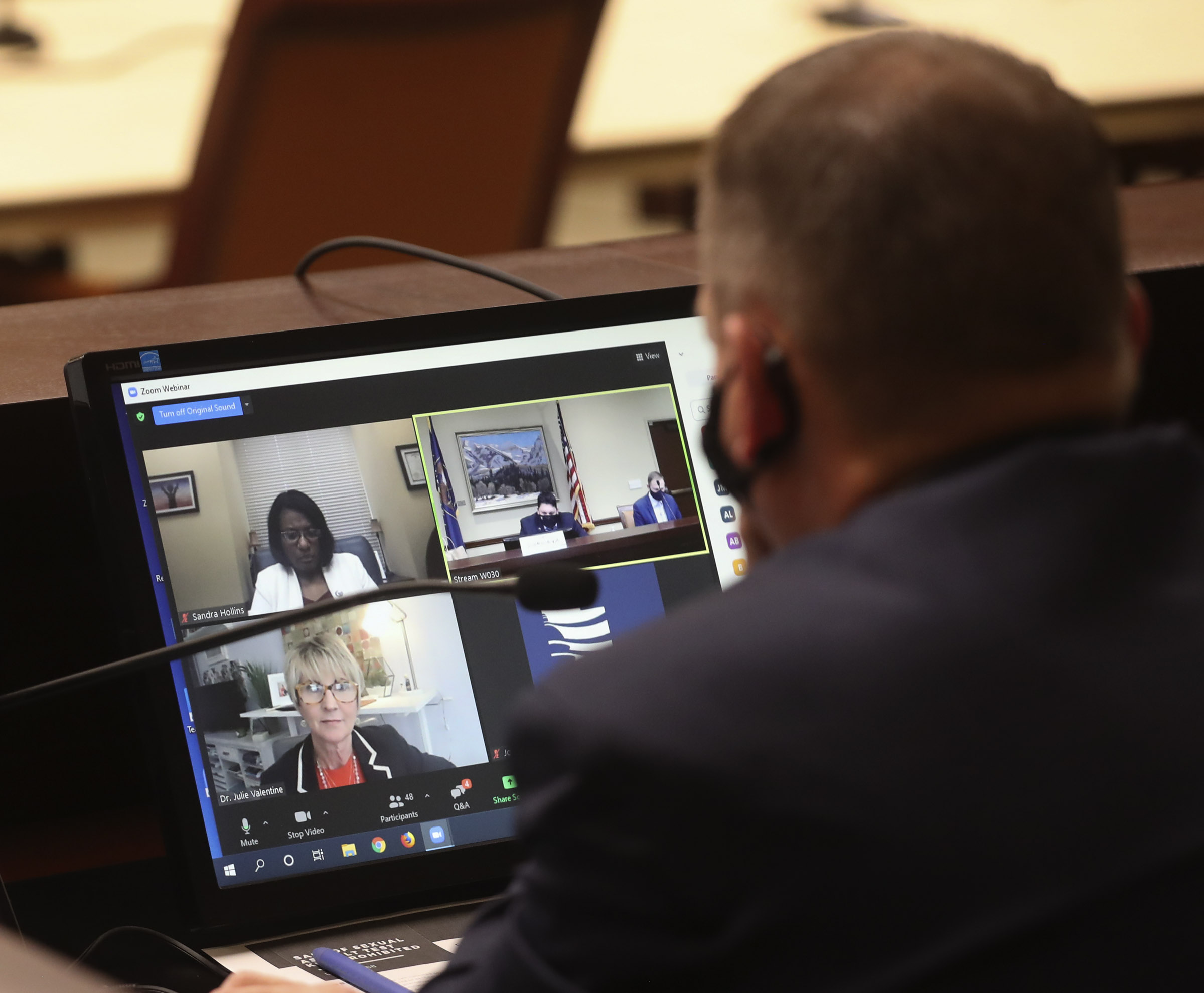 Rep. Paul Ray, R-Clearfield, listens to Dr. Julie Valentine, a BYU professor and sexual assault nurse examiner, bottom left, as she speaks on a Zoom call during a House Law Enforcement and Criminal Justice Standing Committee in the House Building at the Capitol complex in Salt Lake City on Friday, Jan. 22, 2021. Valentine discussed HB0168, which seeks to prohibit over-the-counter sexual assault evidence kits.