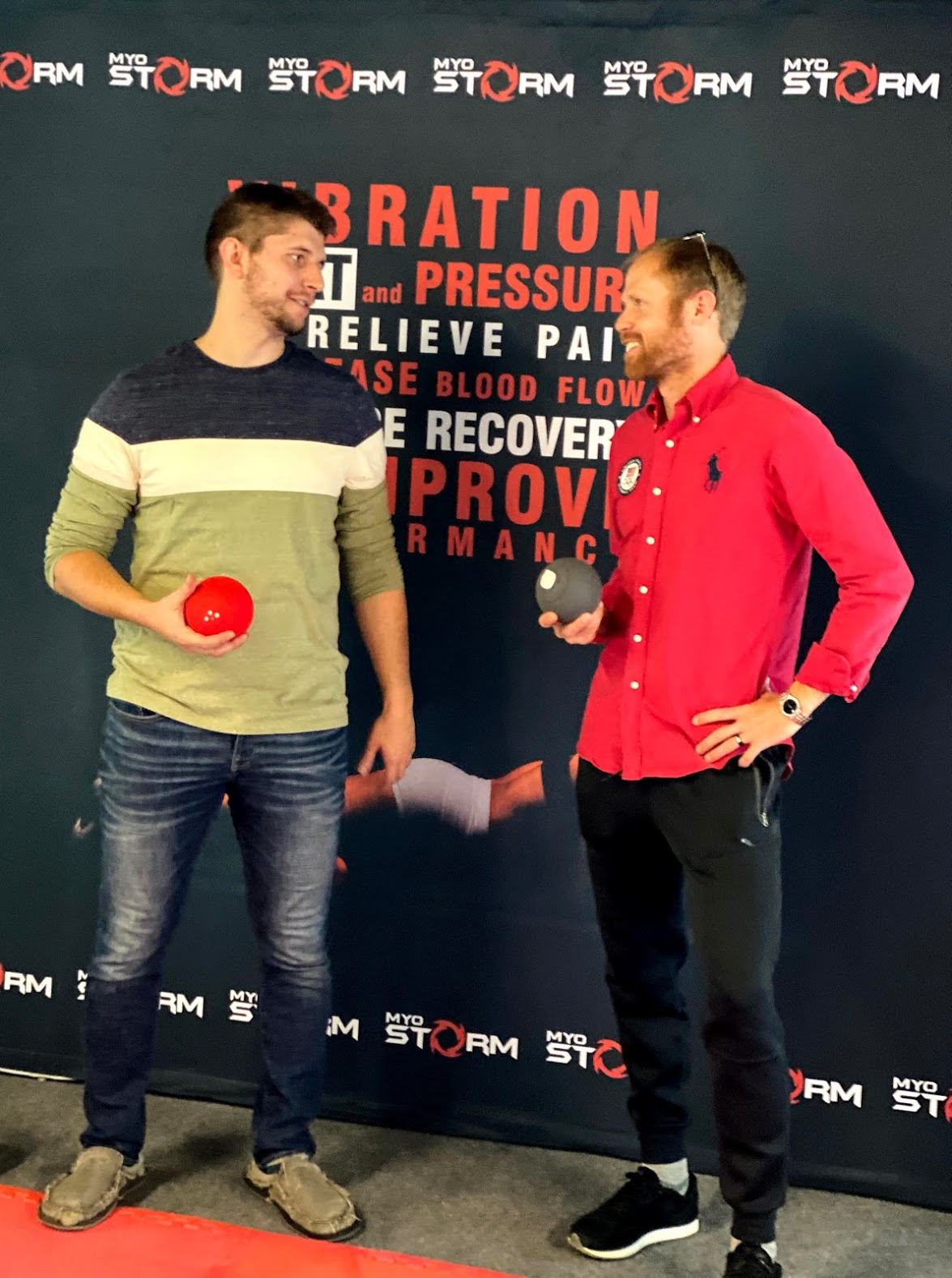 Jono Diperi, left, and Jared Ward show off the MyoStorm Meteor heat therapy massage ball.
