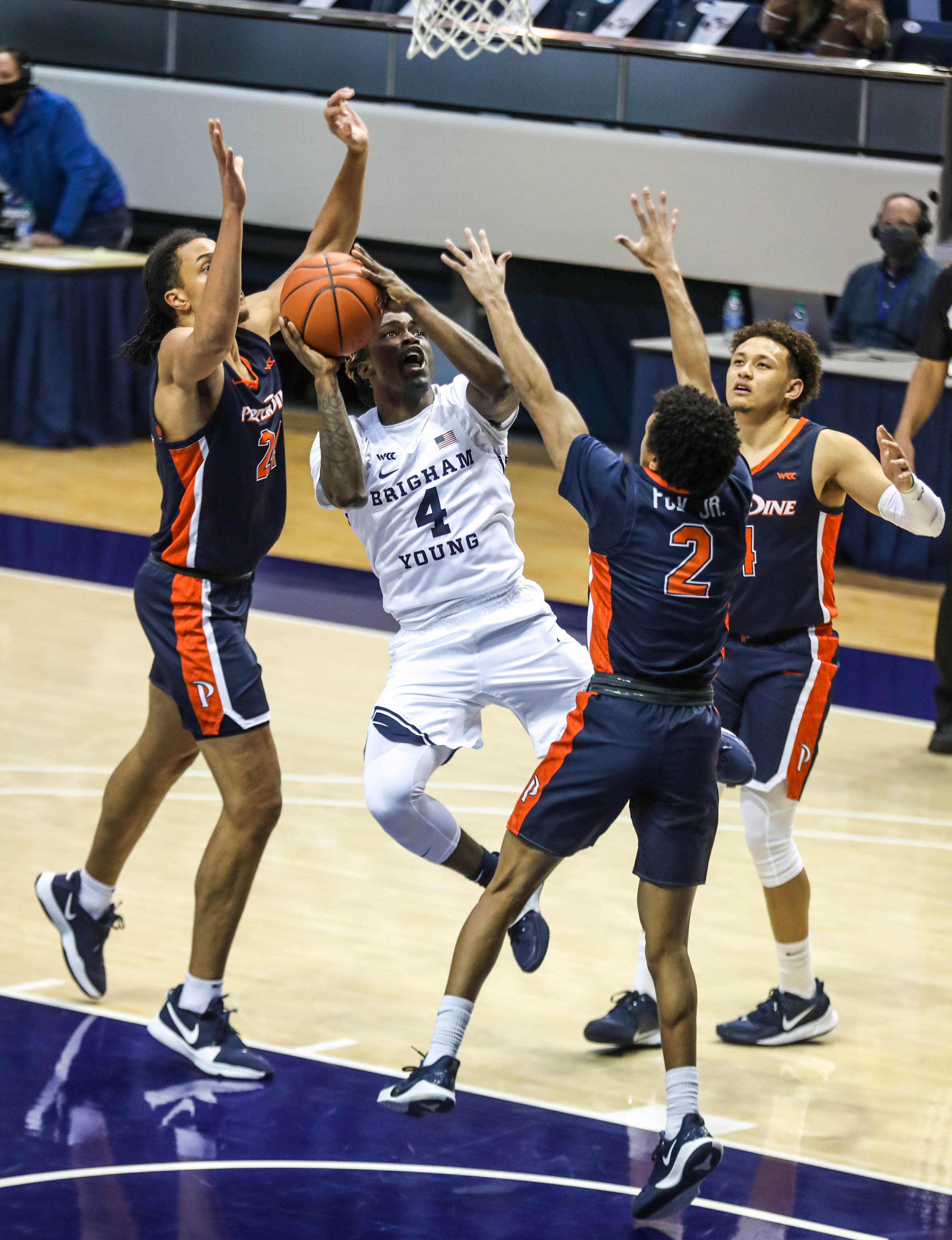 Brigham Young Cougars guard Brandon Averette (4) gets ready to shoot over the Pepperdine Waves at the Marriott Center in Provo on Saturday, Jan. 23, 2021.