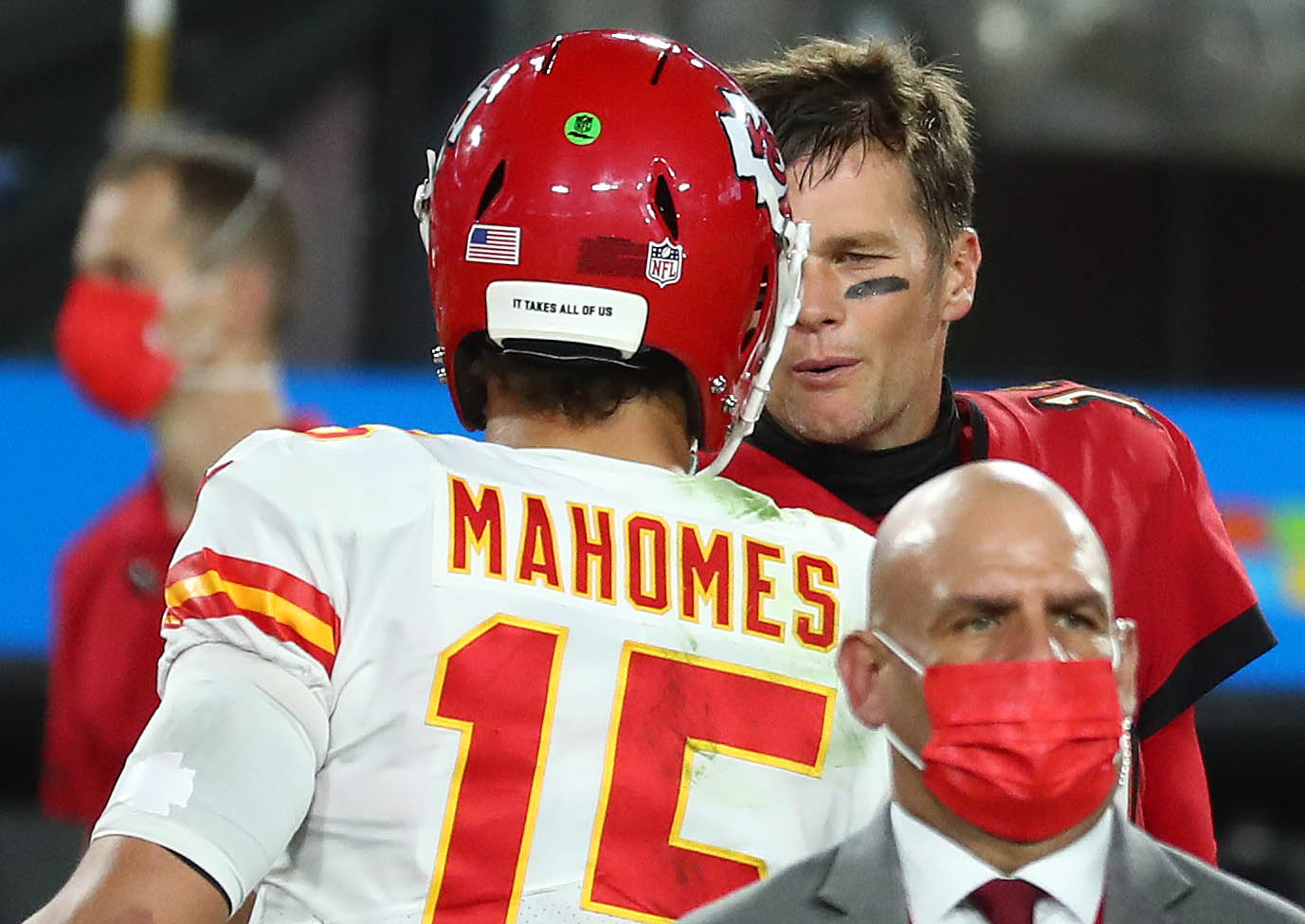 Kansas City Chiefs quarterback Patrick Mahomes (15) meets with Tampa Bay Buccaneers quarterback Tom Brady (12) following the victory at Raymond James Stadium.