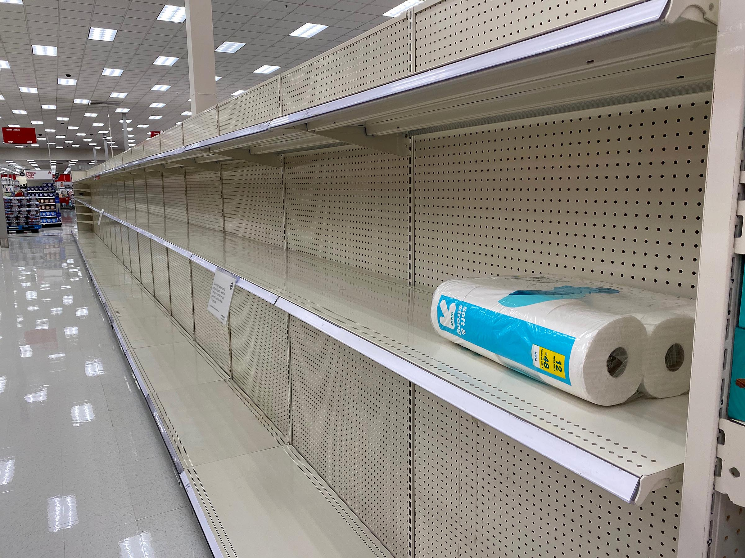 A single package of toilet paper is all that remains on shelves at a Target in Sandy on Tuesday April 14, 2020. Grocery and warehouse stores are hoping to avoid the hoarding of certain household items that took place last spring.