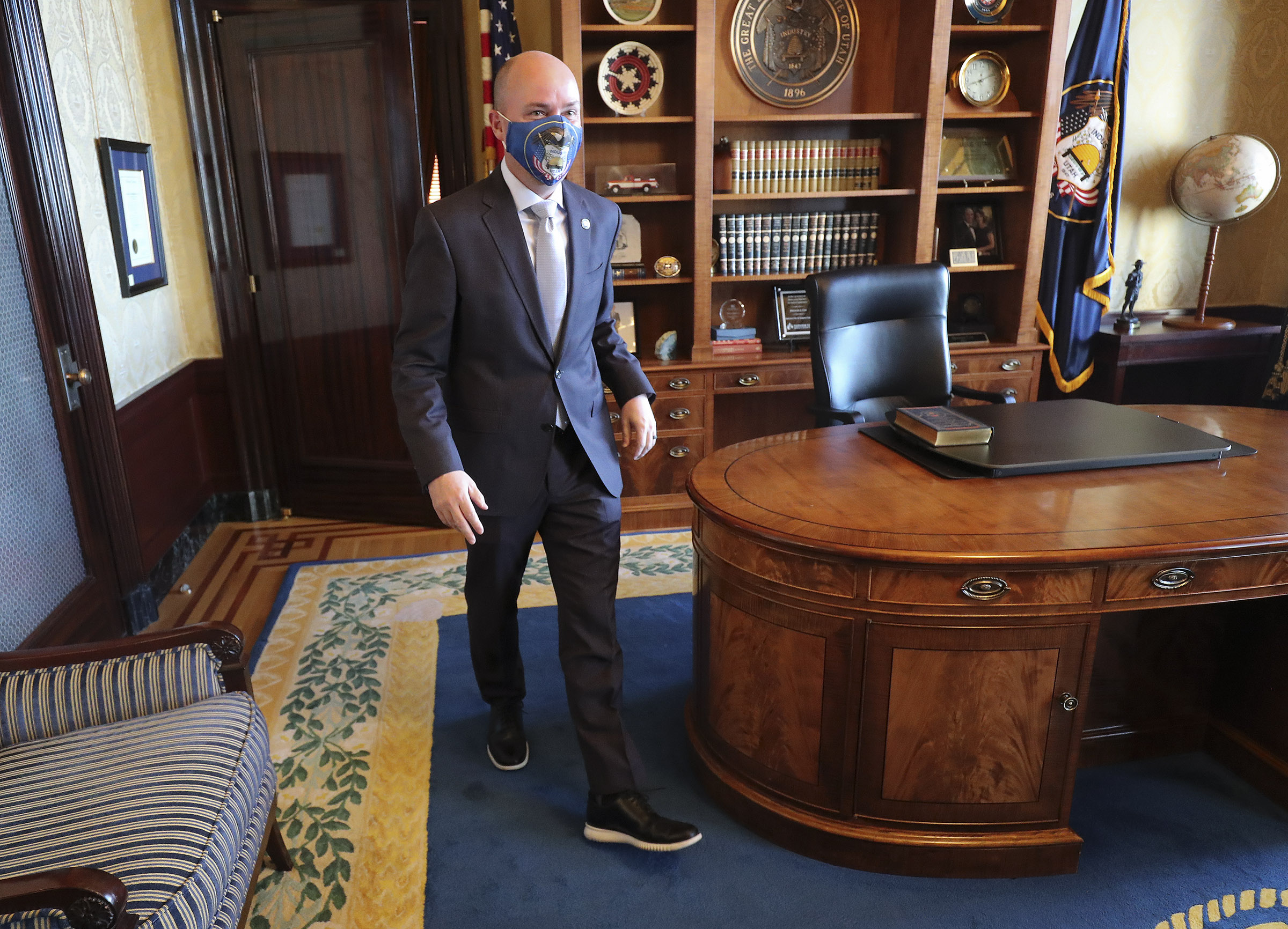 Gov. Spencer Cox walks through his office at the Capitol in Salt Lake City on Tuesday, Jan. 5, 2021.