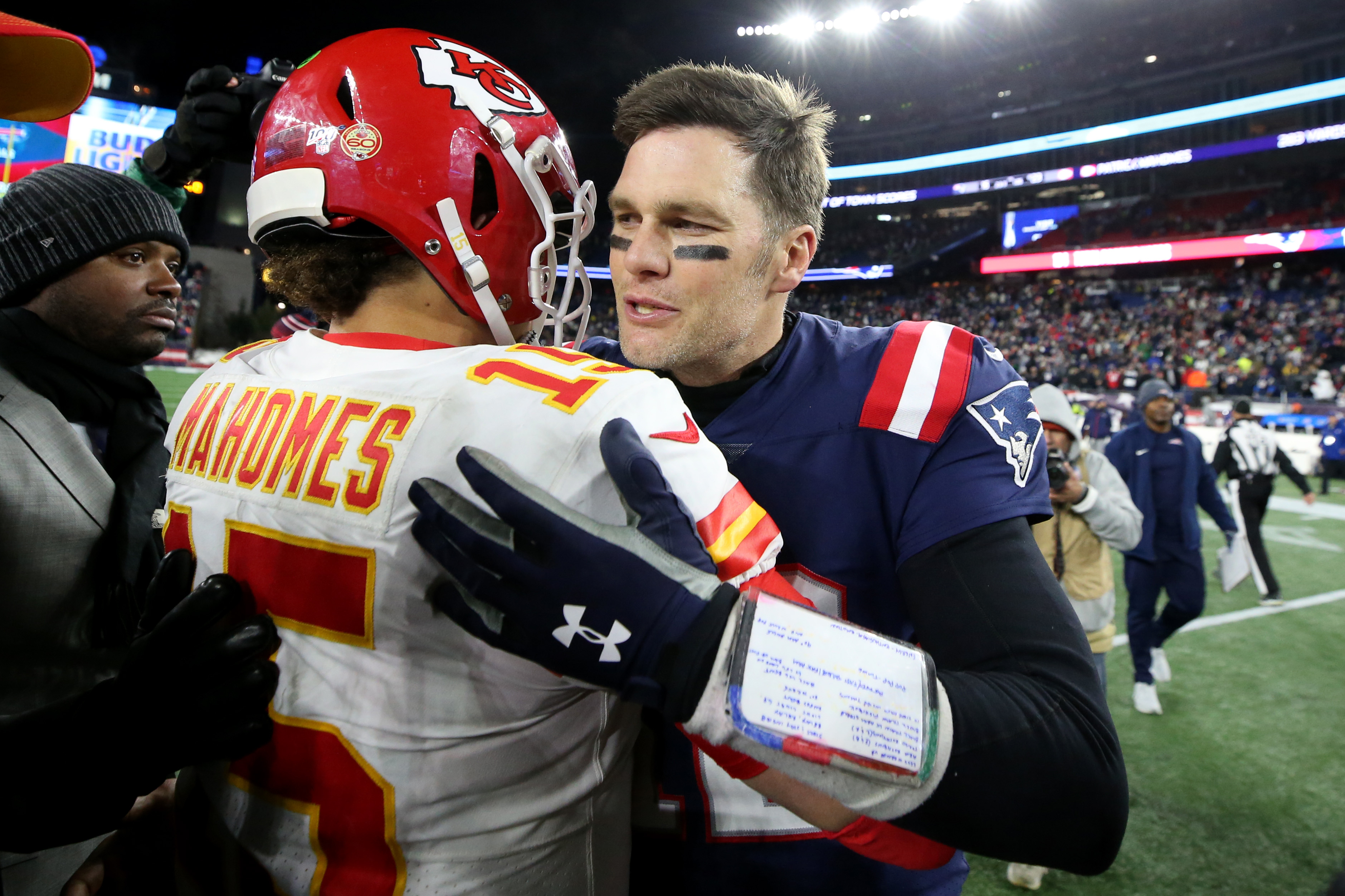 Tom Brady of the New England Patriots talks with Patrick Mahomes of the Kansas City Chiefs after the Chief defeat the Patriots 23-16 at Gillette Stadium on December 08, 2019 in Foxborough, Massachusetts.