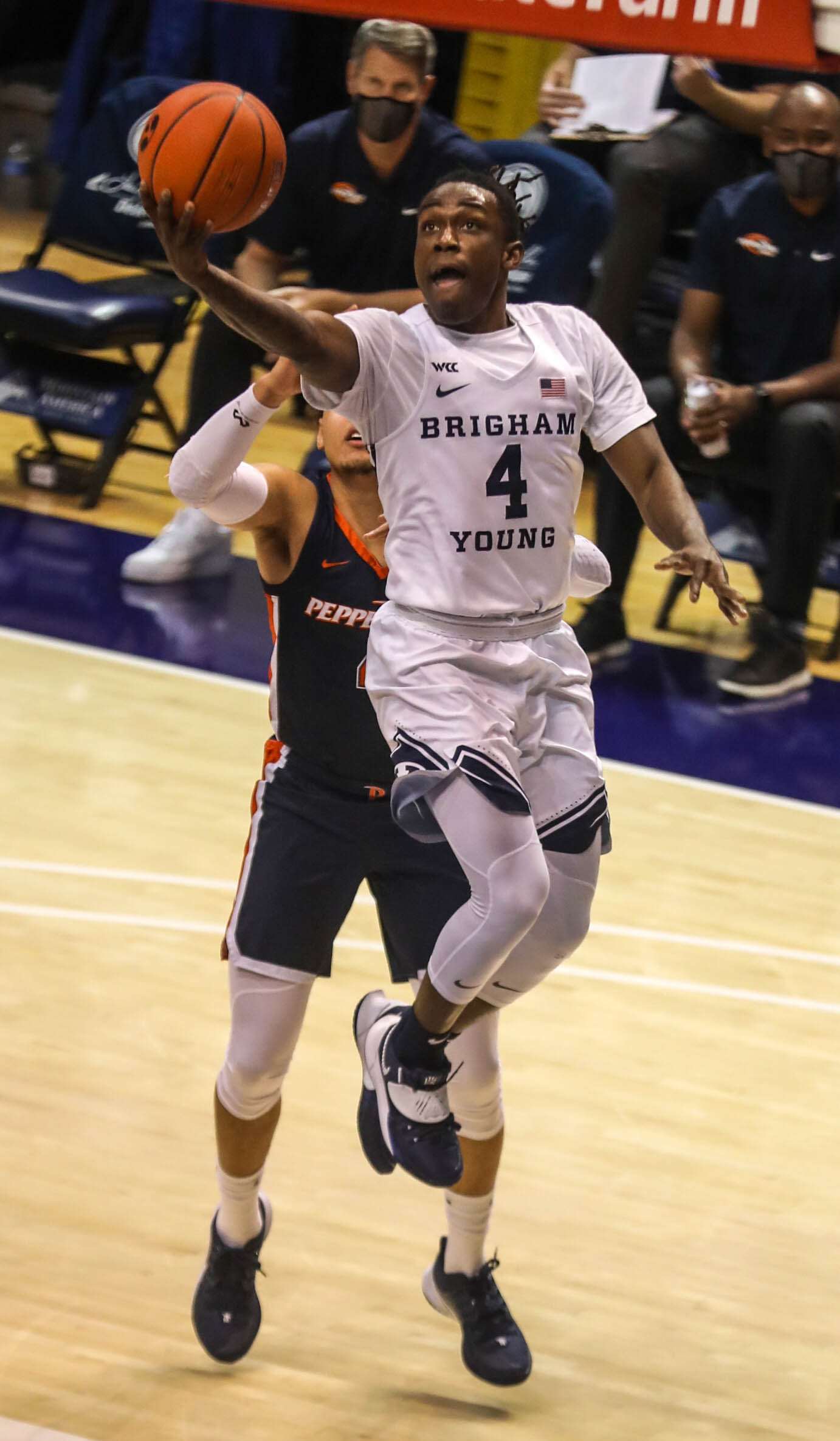 Brigham Young Cougars guard Brandon Averette (4) does a layup at the Marriott Center in Provo on Saturday, Jan. 23, 2021.