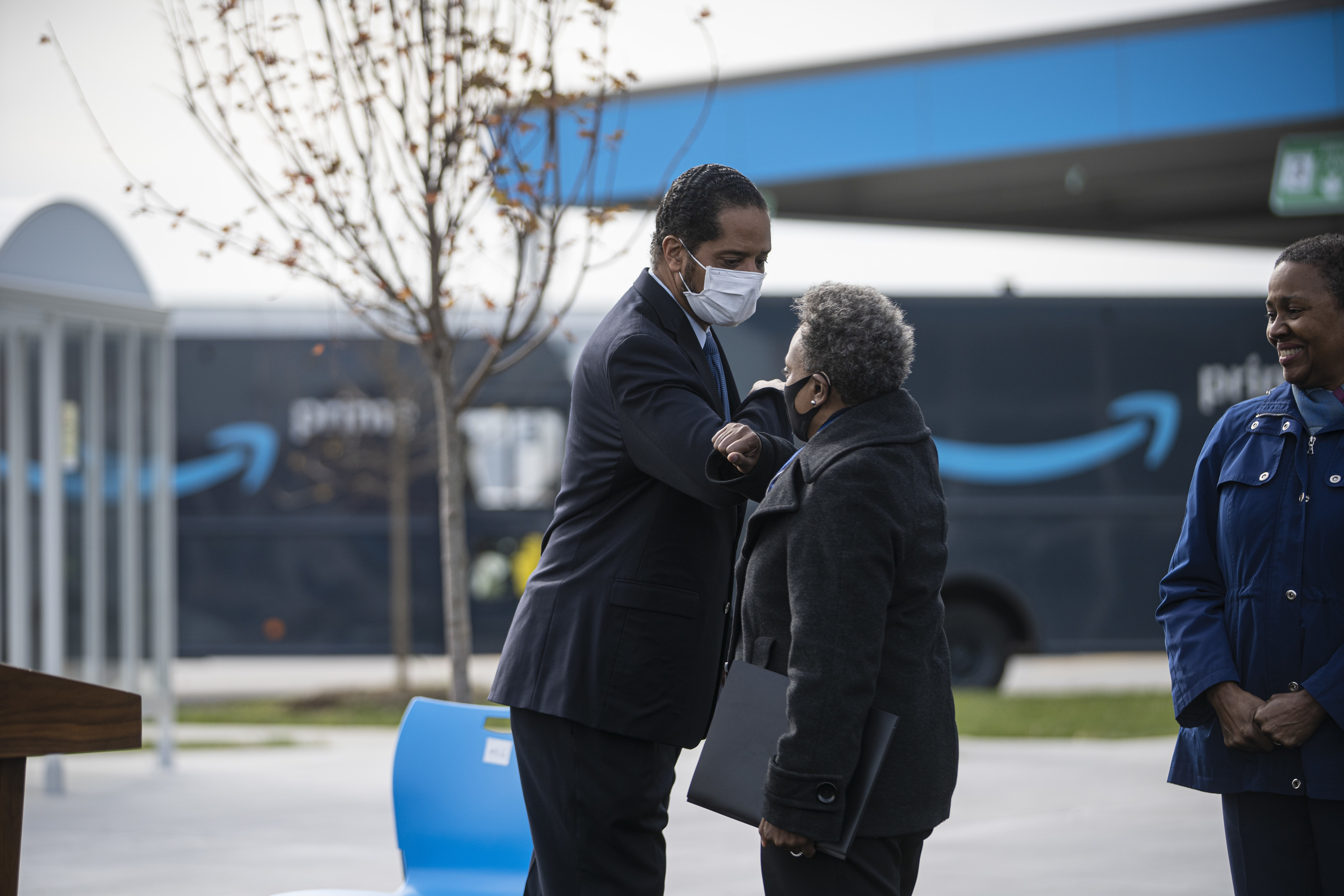 Ald. AnthonyBeale (9th) and Mayor Lori Lightfoot greet one another Wednesday, Oct. 28, 2020 at the ceremonial opening of Chicago's first Amazon Delivery Station, 10500 S. Woodlawn Ave. in Pullman.
