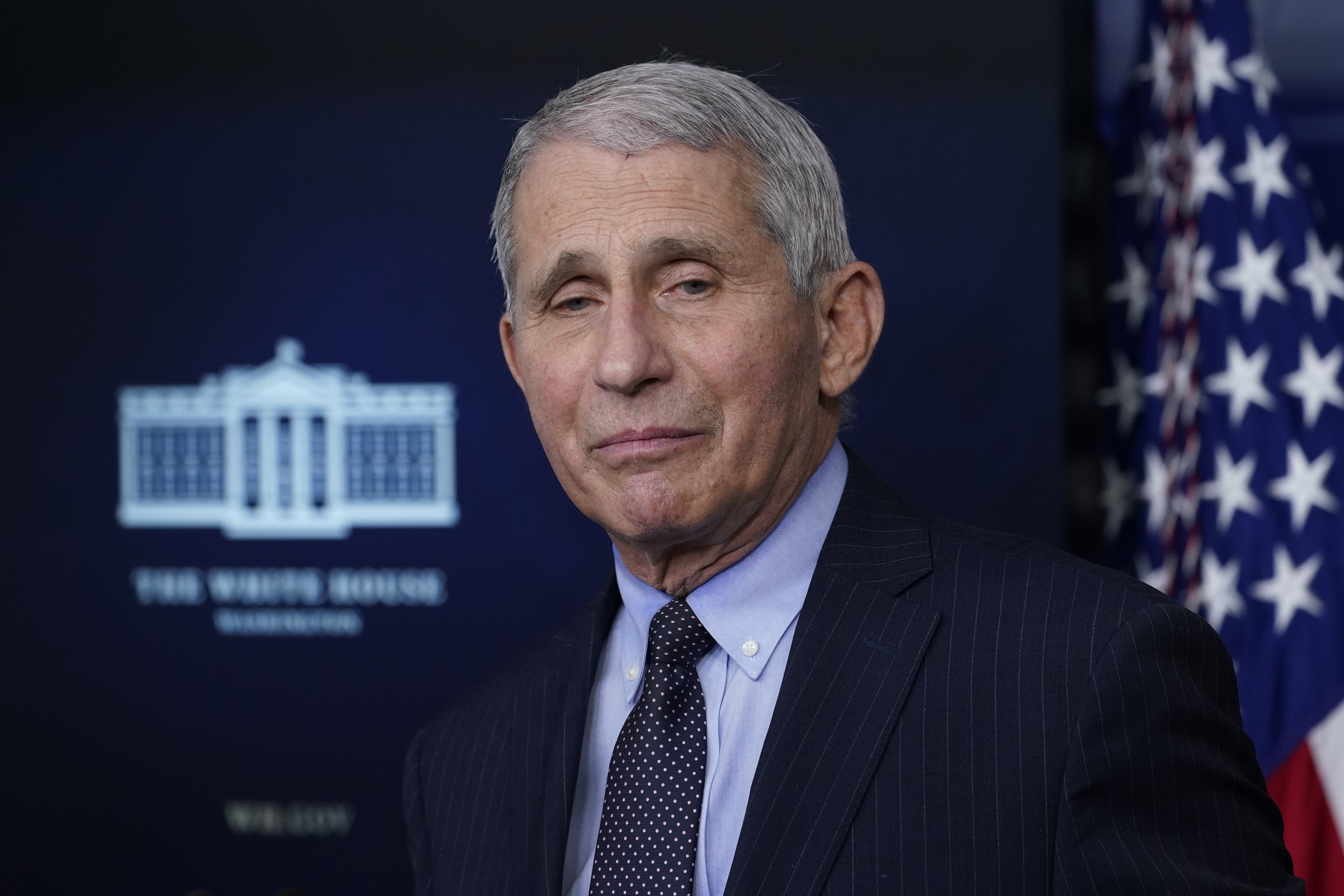 Dr. Anthony Fauci, director of the National Institute of Allergy and Infectious Diseases, listens as he speaks with reporters in the James Brady Press Briefing Room at the White House, Thursday, Jan. 21, 2021, in Washington.