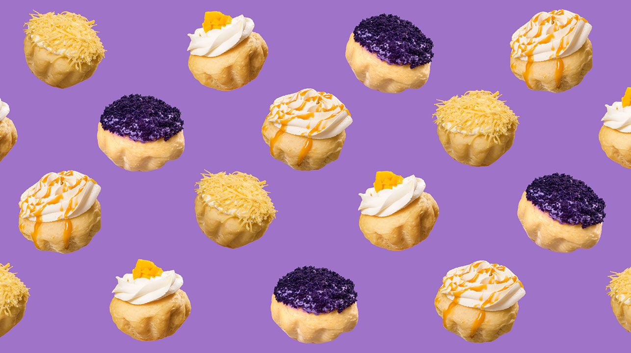 Little ensaymadas, with different toppings, on a purple background