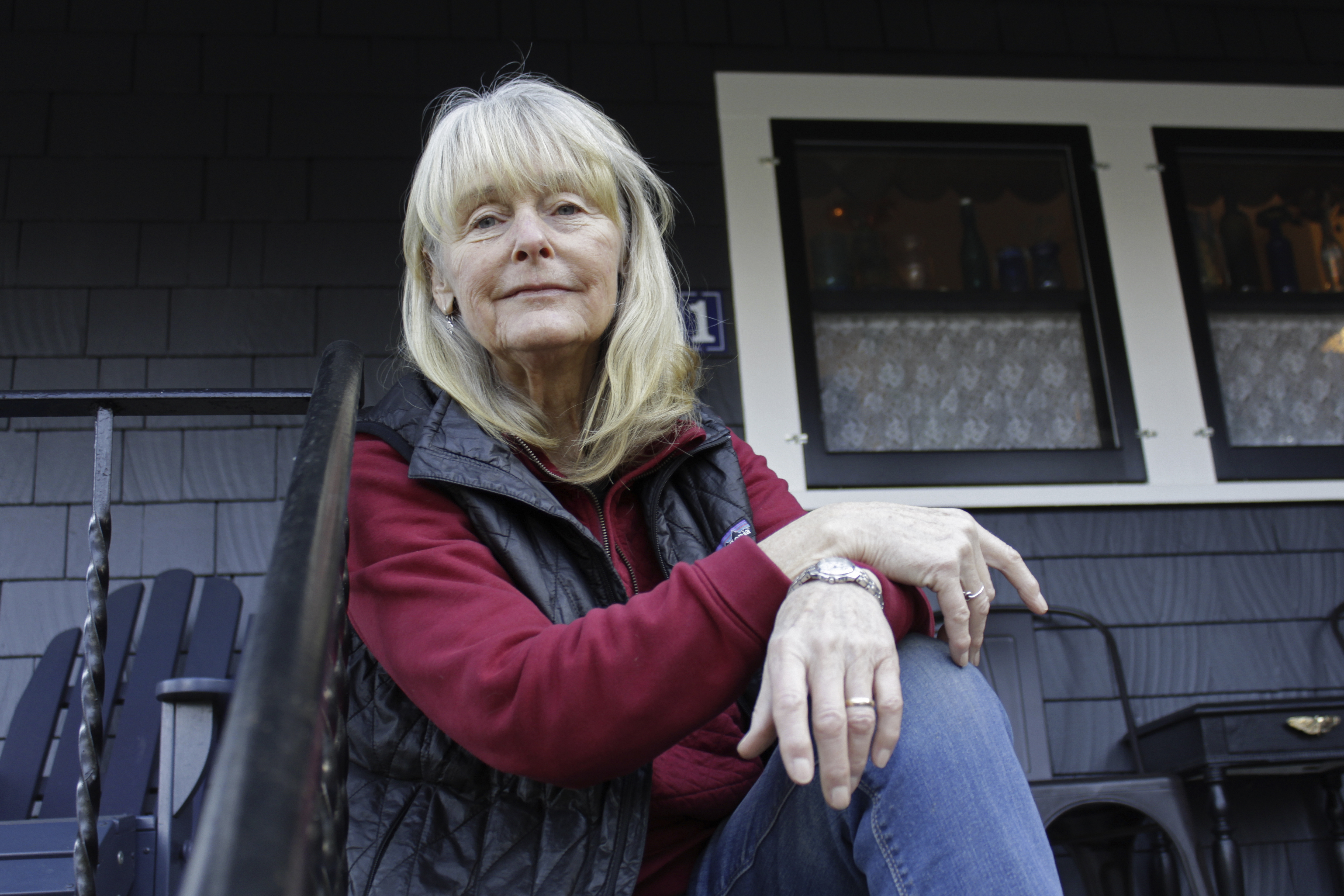 Susan Crowley, a 75-year-old retired attorney, sits outside her home in Hood River, Ore., on Jan. 23, 2021.