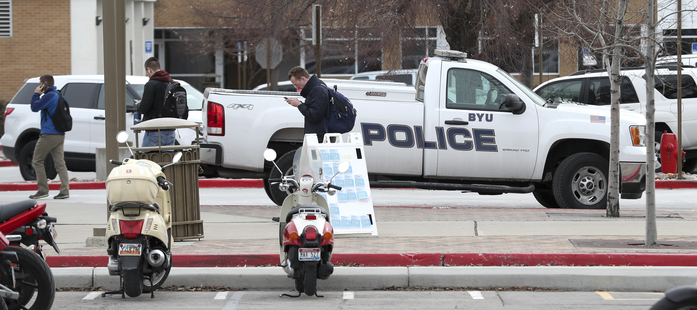 BYU police vehicles are parked outside the department's offices on the BYU campus in Provo on Thursday, Feb. 21, 2019.