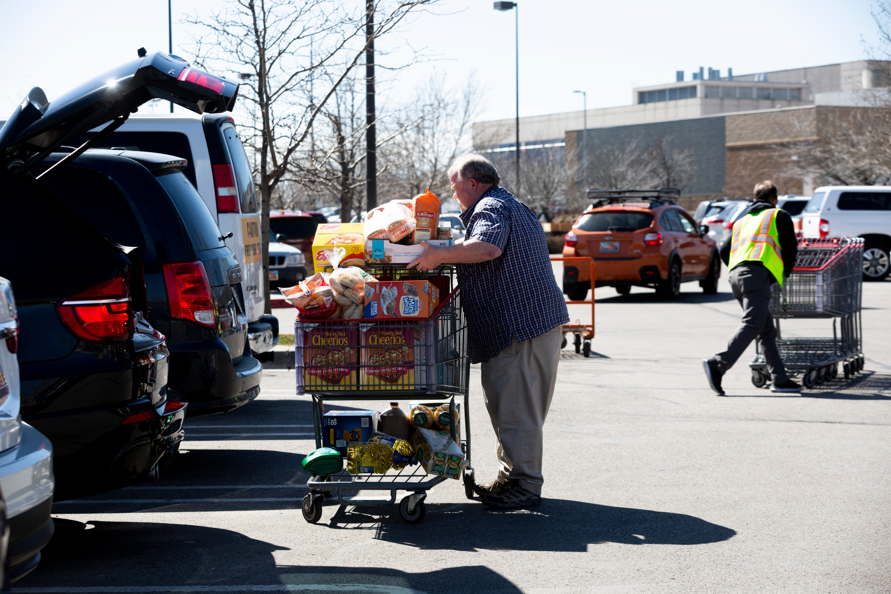 Jeff Duke loads items into the trunk of his car in the Costco parking lot in Murray on Thursday, March 12, 2020. Many shoppers were stocking up on items as the coronavirus spreads.