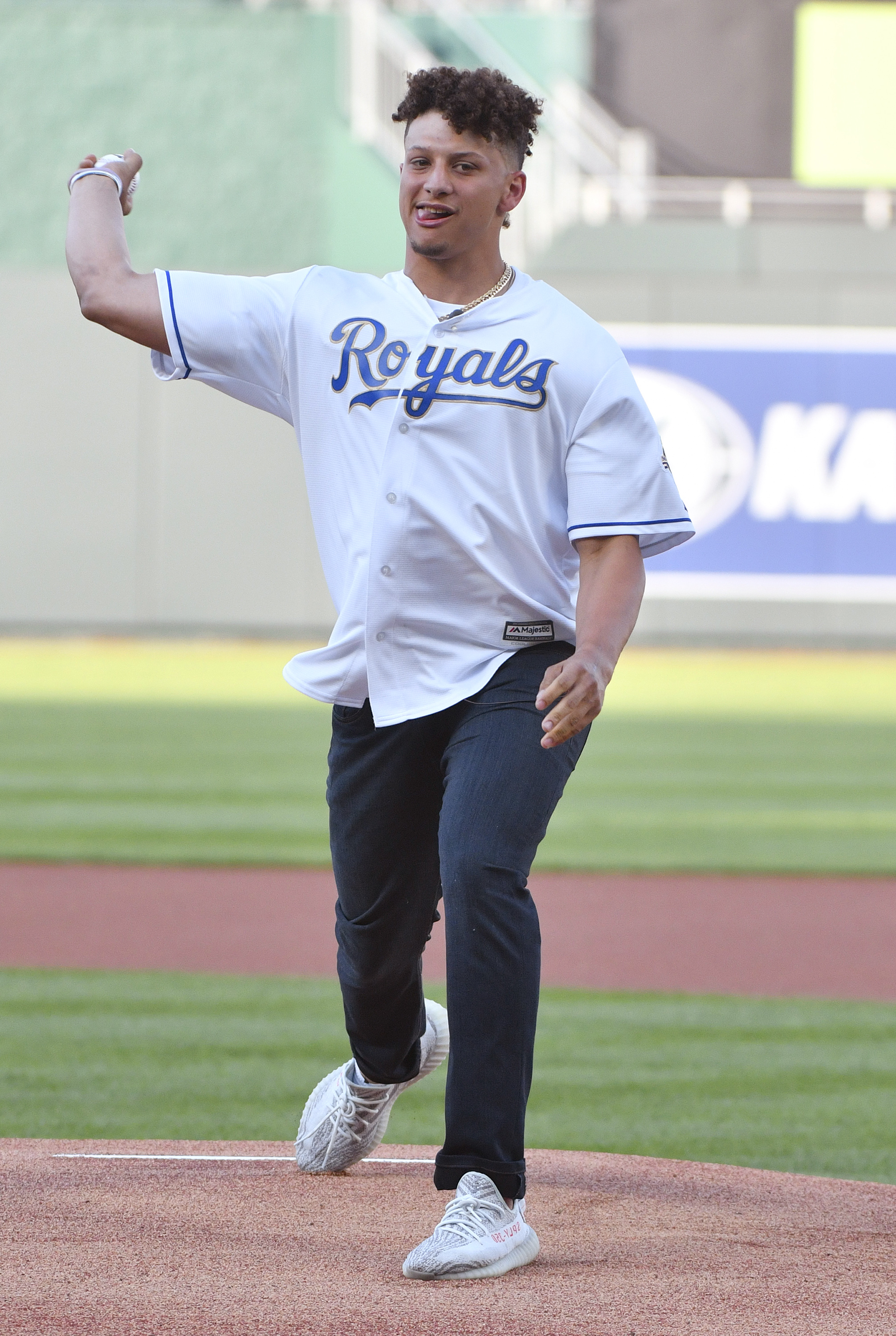 Quarterback Patrick Mahomes of the Kansas City Chiefs throws out the first pitch prior to a game between the New York Yankees and Kansas City Royals at Kauffman Stadium on May 18, 2018 in Kansas City, Missouri.