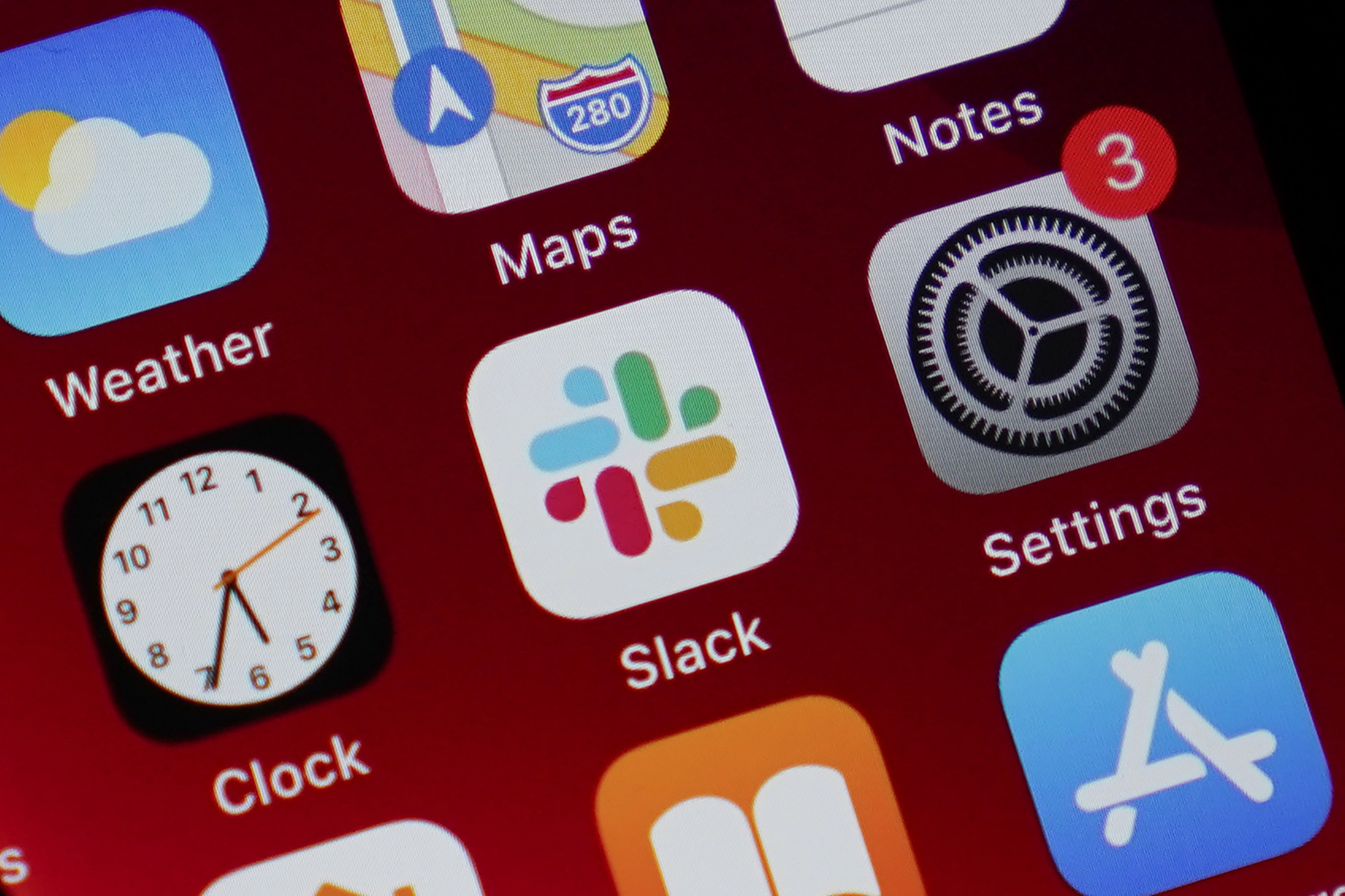 The Slack app icon is displayed on an iPhone screen, Tuesday, Dec. 1, 2020, in Long Beach, Calif. Apple has called on everyone to update their iPhones again to deal with security bugs.