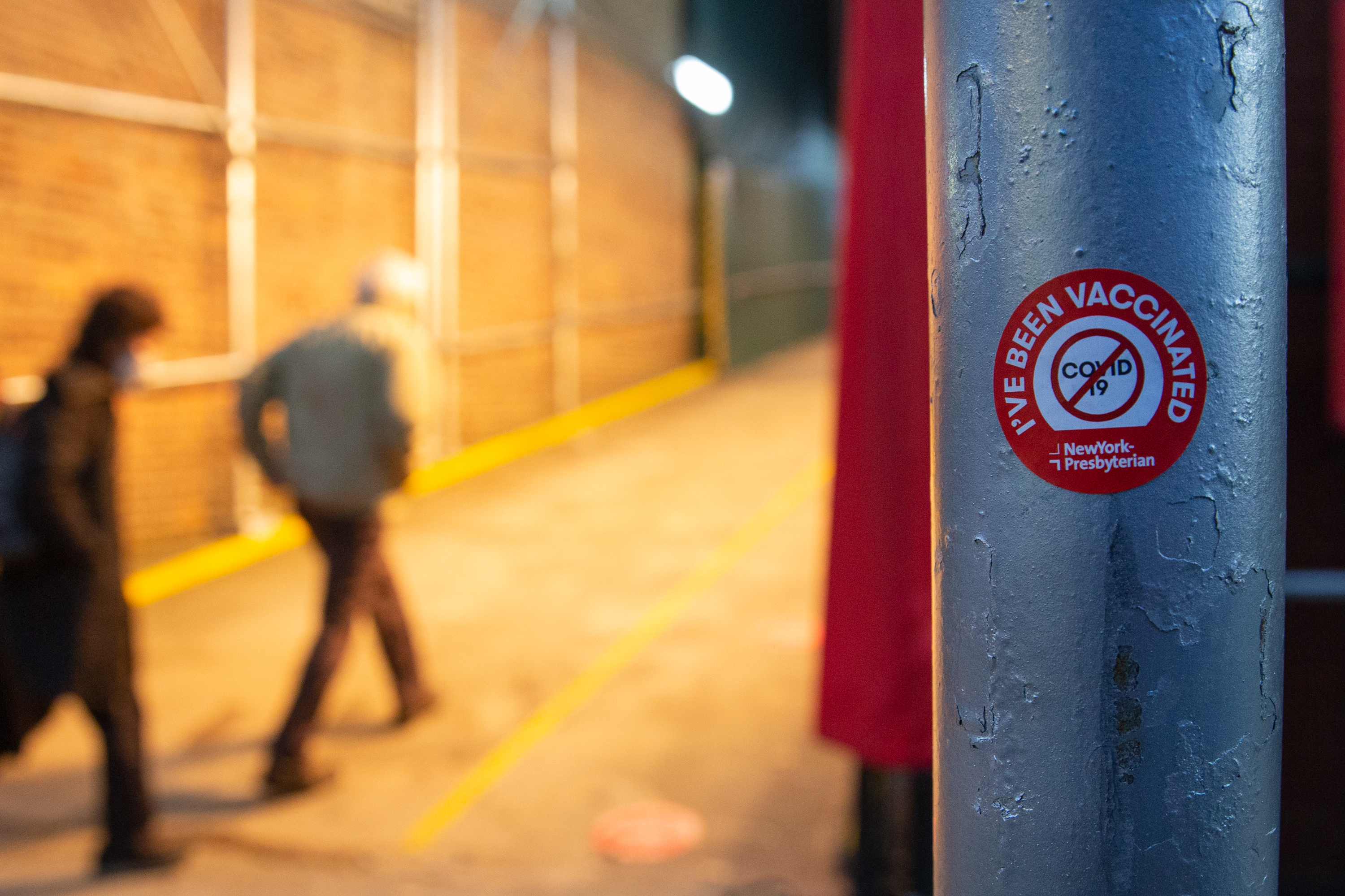 People arrive early in the morning to get their coronavirus vaccine at the Washington Heights armory, Jan. 26, 2021.